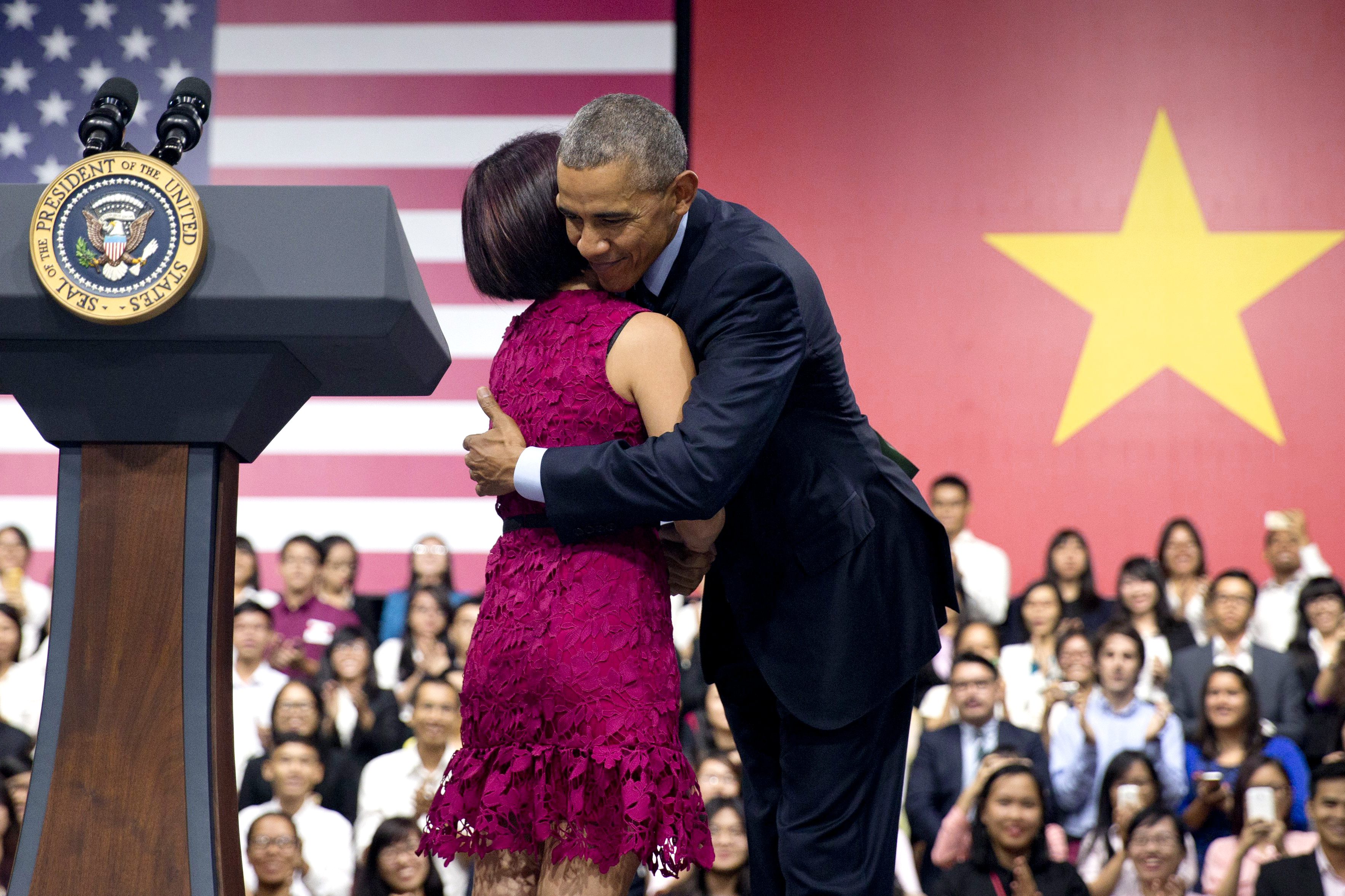 U.S. President Barack Obama embraces Tu Ngo, a member of the YSEALI Network, after she introduces him during the Young Southeast Asian Leaders Initiative (YSEALI) town hall at the GEM Center in Ho Chi Minh City, Vietnam, May 25, 2016.