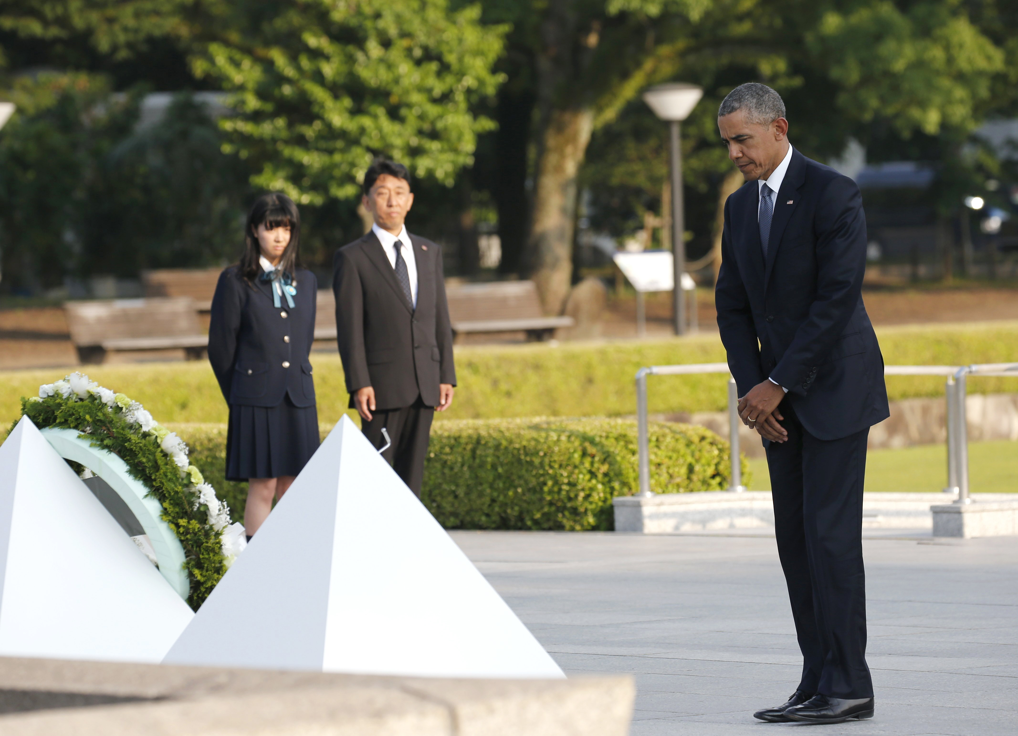 U.S. President Barack Obama stands after laying a wreath at the Hiroshima Peace Memorial Park in Hiroshima, western, Japan, Friday, May 27, 2016. Obama on Friday became the first sitting U.S. president to visit the site of the world's first atomic bomb attack.