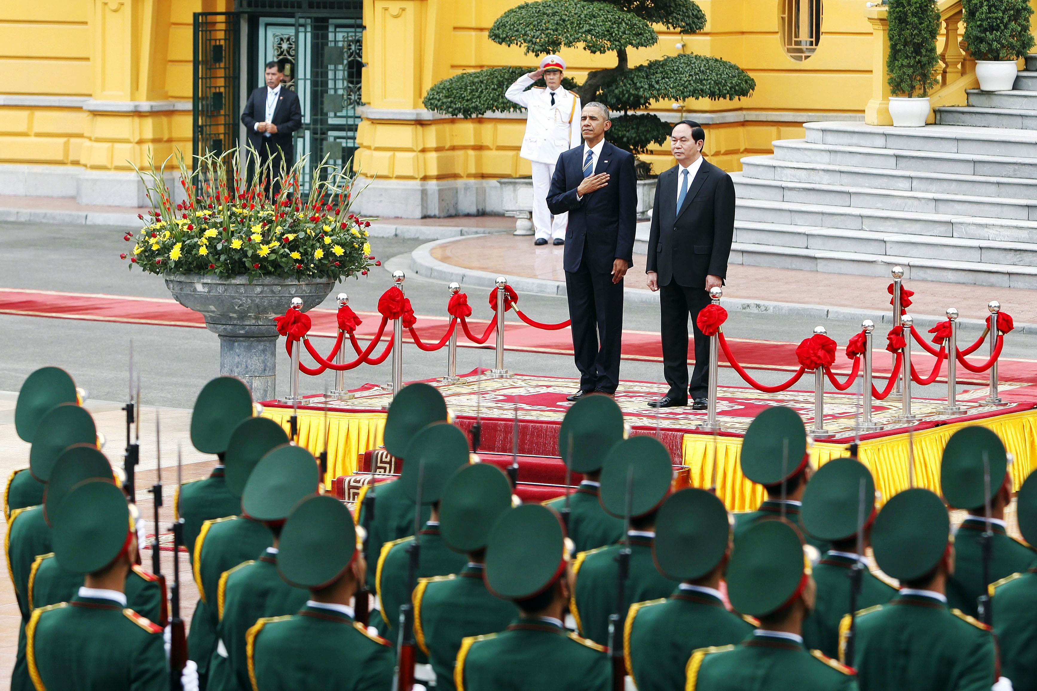 U.S. President Barack Obama and Vietnam's President Tran Dai Quang review an honor guard at the Presidential Palace in Hanoi, Vietnam on May 23, 2016.