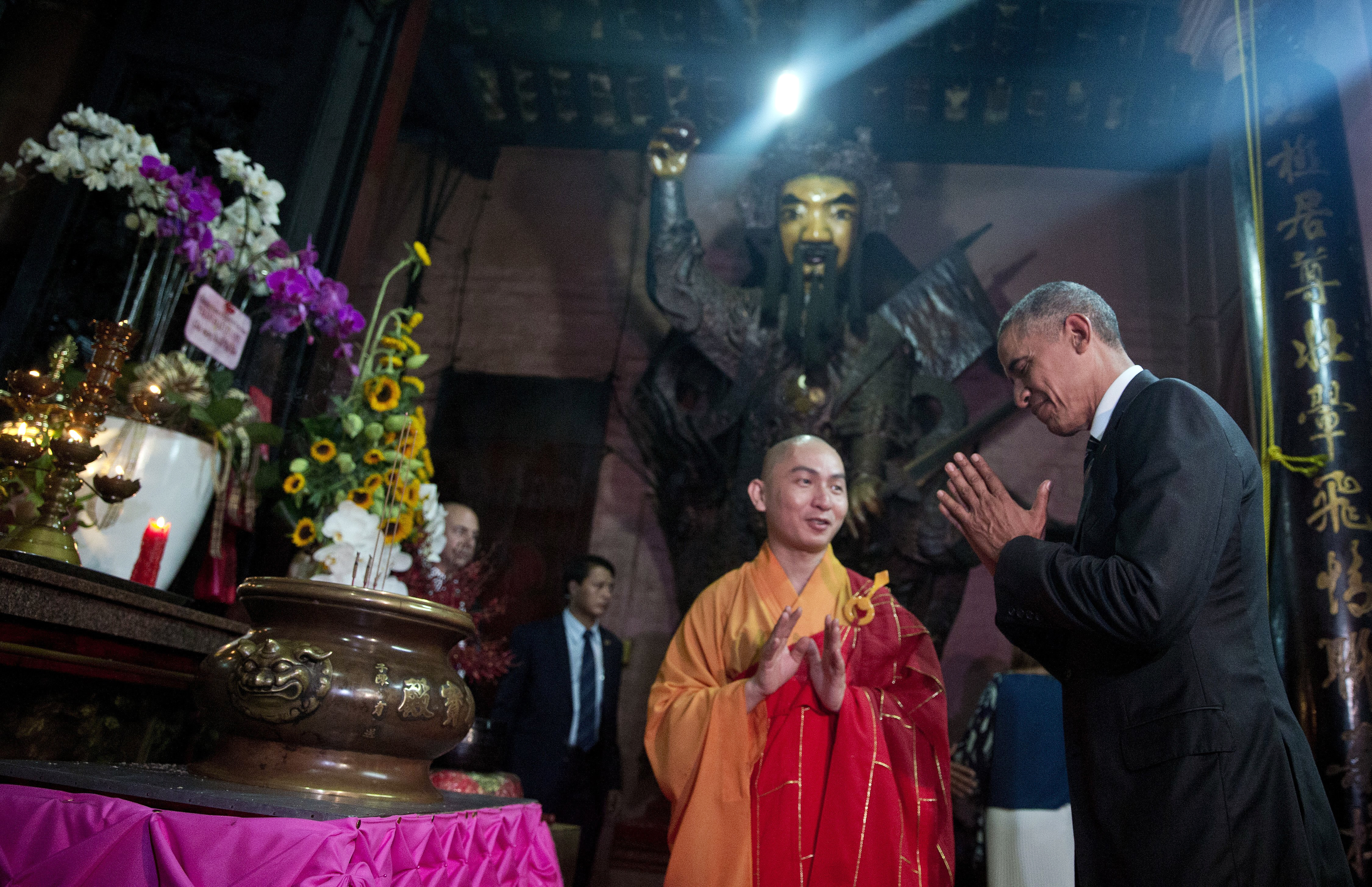 U.S. President Barack Obama bows as he visits the Jade Emperor Pagoda with Thich Minh Thong, abbot of the Jade Emperor Pagoda, in Ho Chi Minh City, Vietnam, Tuesday, May 24, 2016.