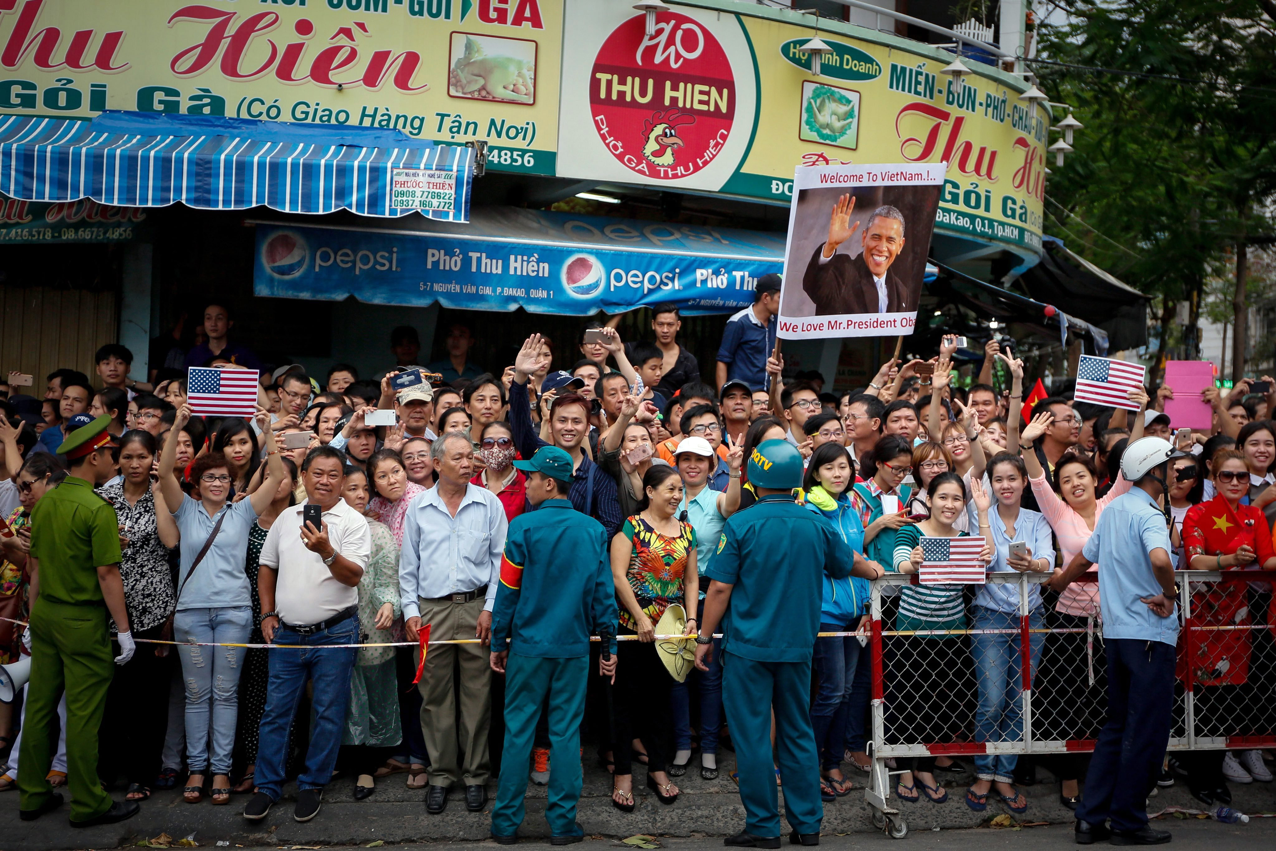 Vietnamese people wait for President Barack Obama outside the Jade Pagoda in Ho Chi Minh City, Vietnam, May 24, 2016.