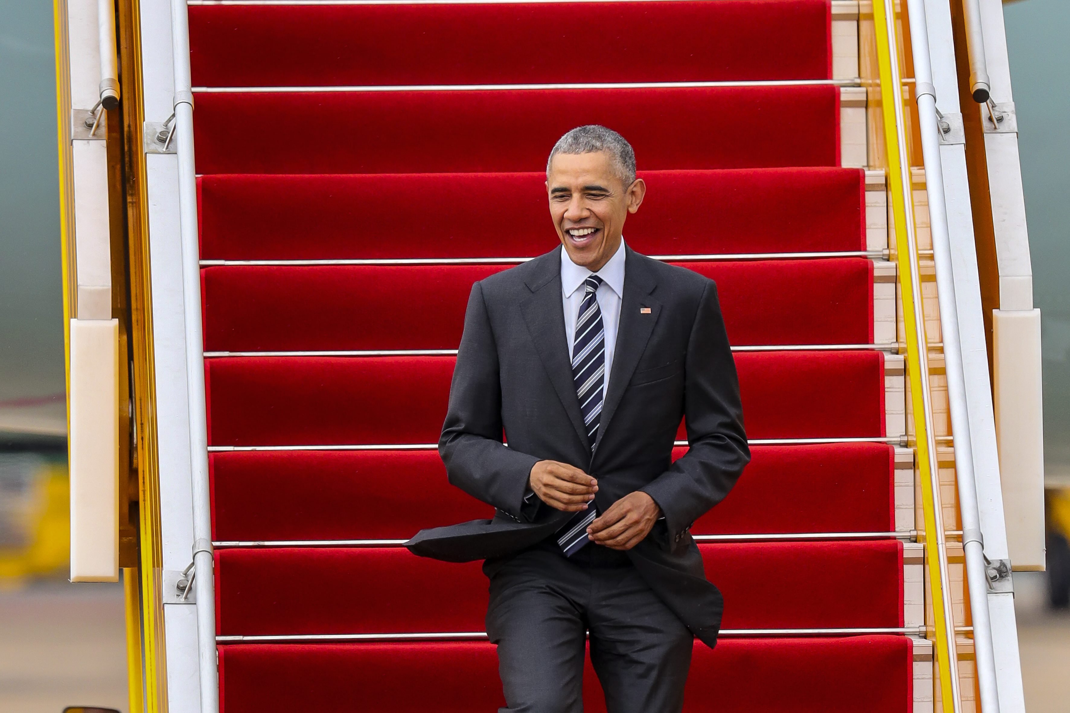 President Barack Obama disembarks Air Force One after landing at Tan Son Nhat airport in Ho Chi Minh City, Vietnam, May 24, 2016.