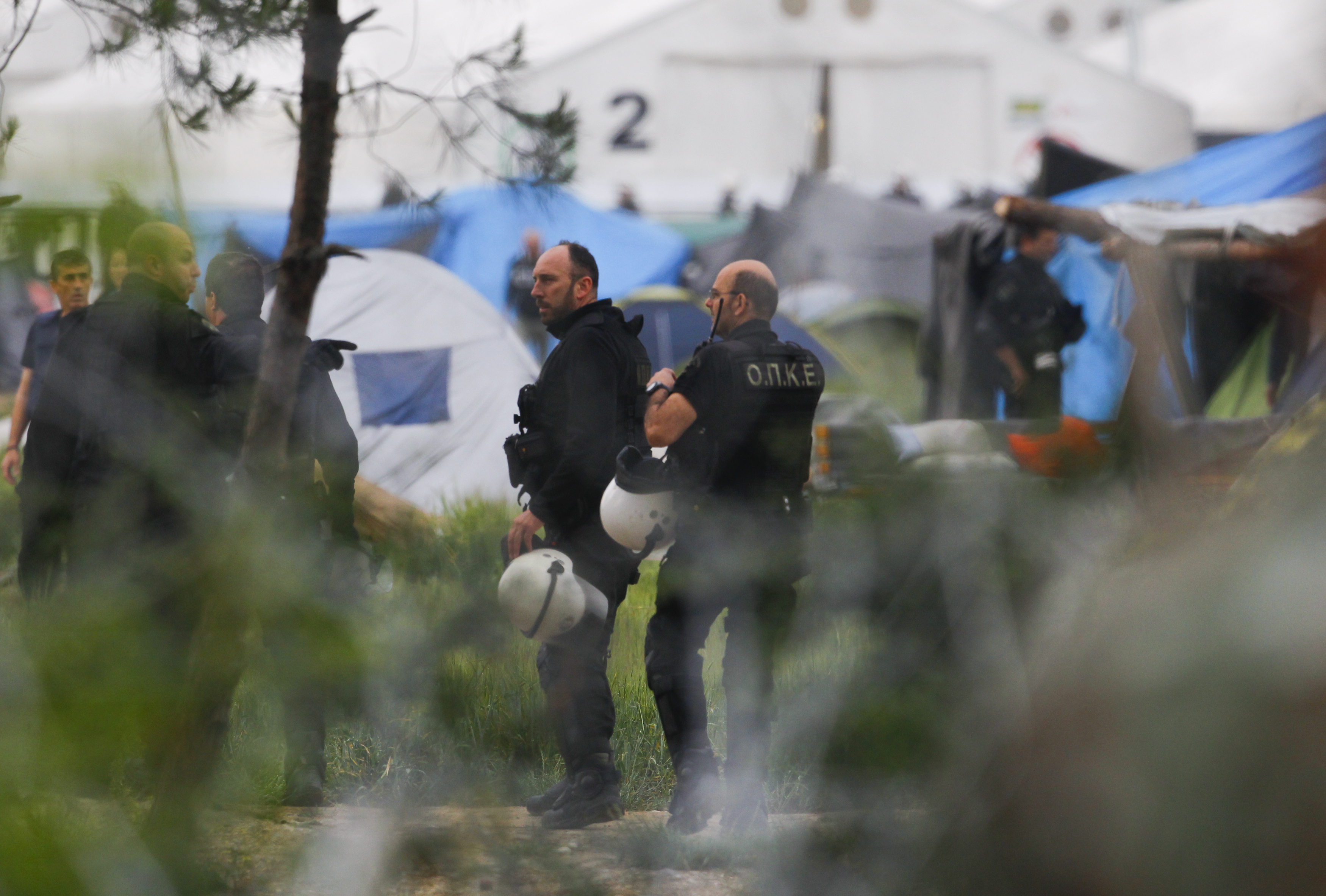 Greek policemen operate at a makeshift camp for migrants and refugees at the Greek-Macedonian border near the village of Idomeni, Greece, on May 24, 2016