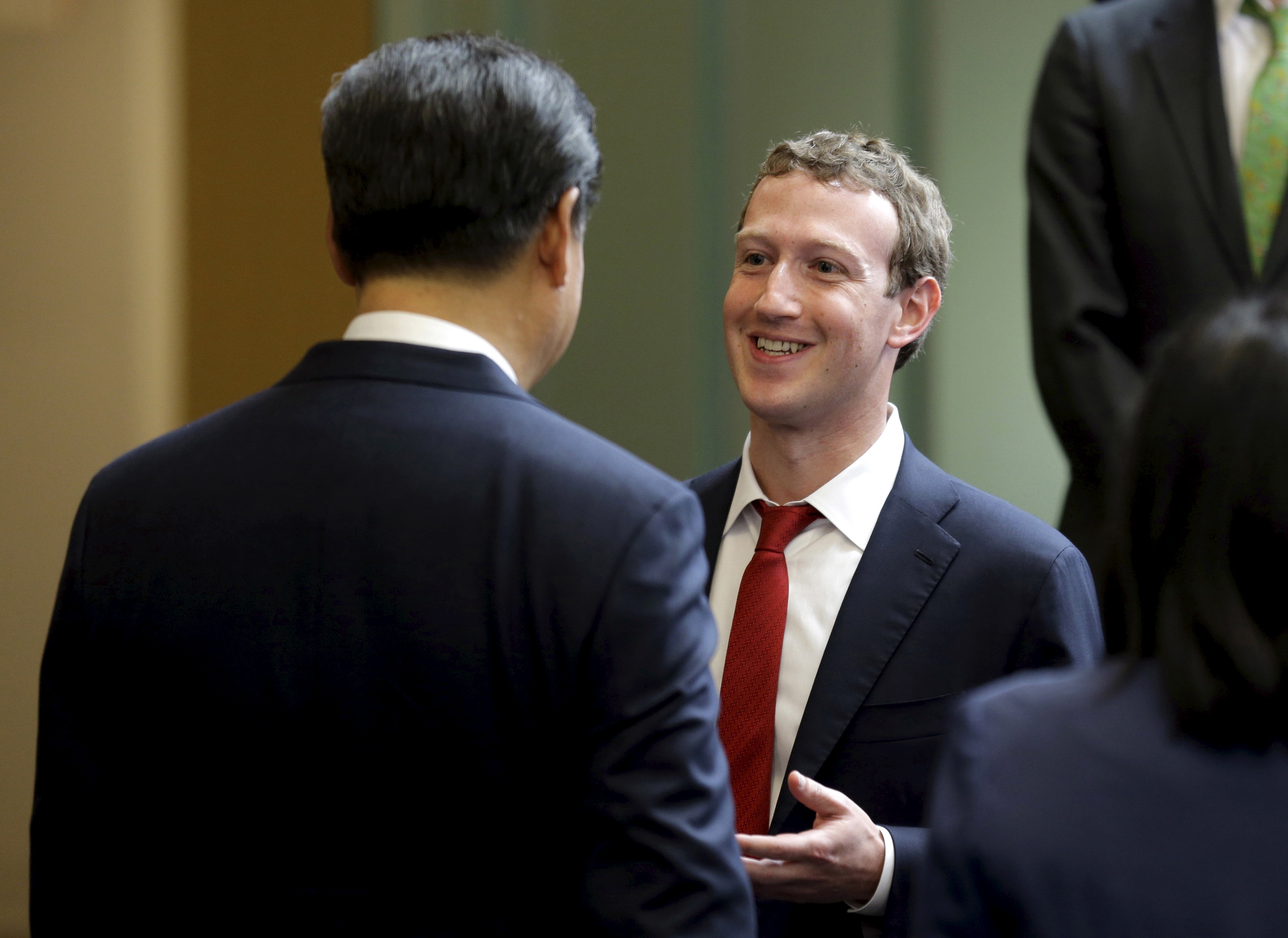Chinese President Xi Jinping. left, talks with Facebook CEO Mark Zuckerberg at Microsoft's main campus in Redmond, Wash., on Sept. 23, 2015