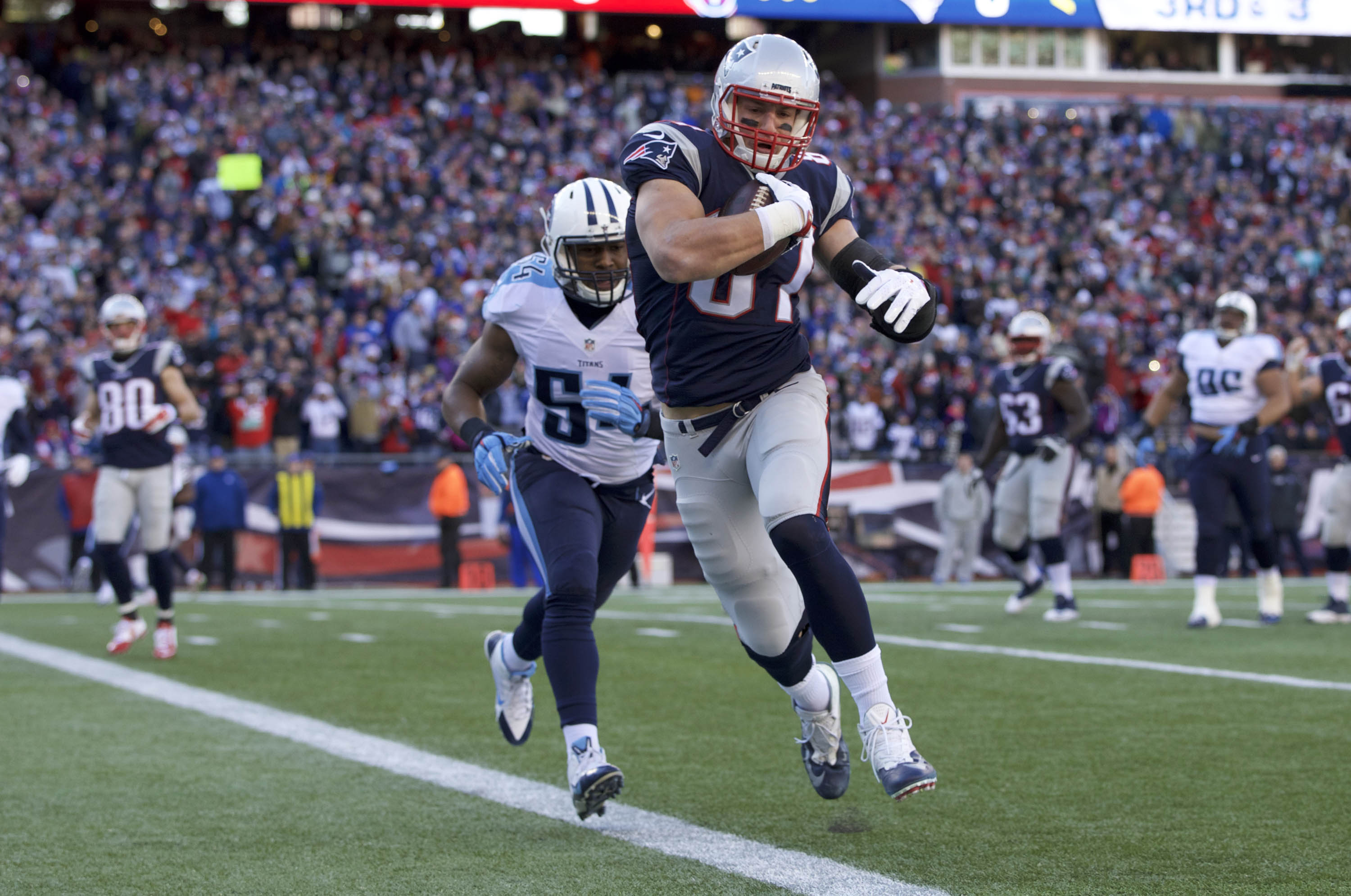 New England Patriots tight end Rob Gronkowski score a touchdown against the Tennessee Titans at Gillette Stadium in Foxborough, Mass., on Dec. 20, 2015
