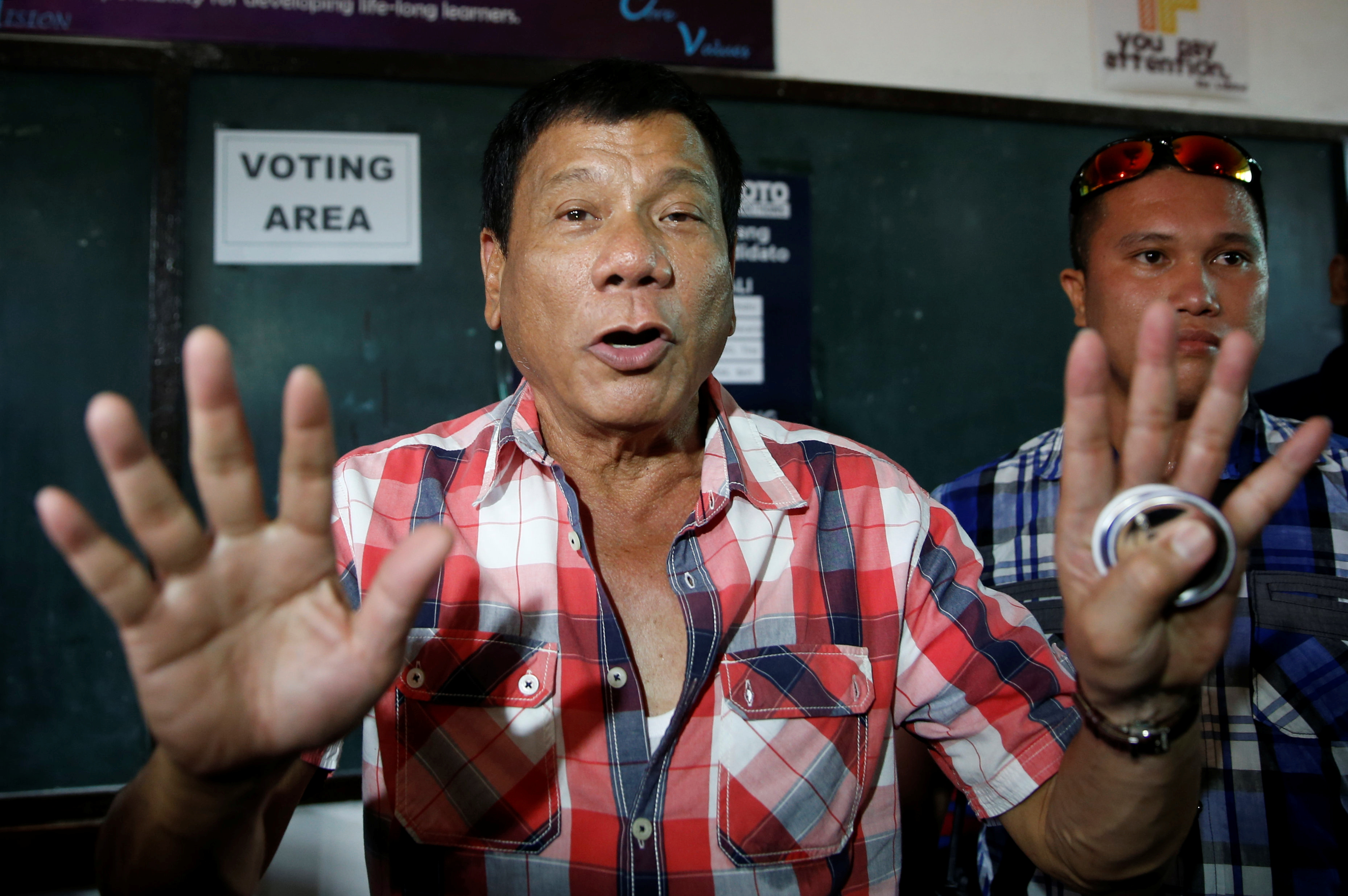 Presidential candidate Rodrigo Duterte talks to the media before casting his vote for national elections at Daniel Aguinaldo National High School in Davao City, in southern Philippines, on May 9, 2016