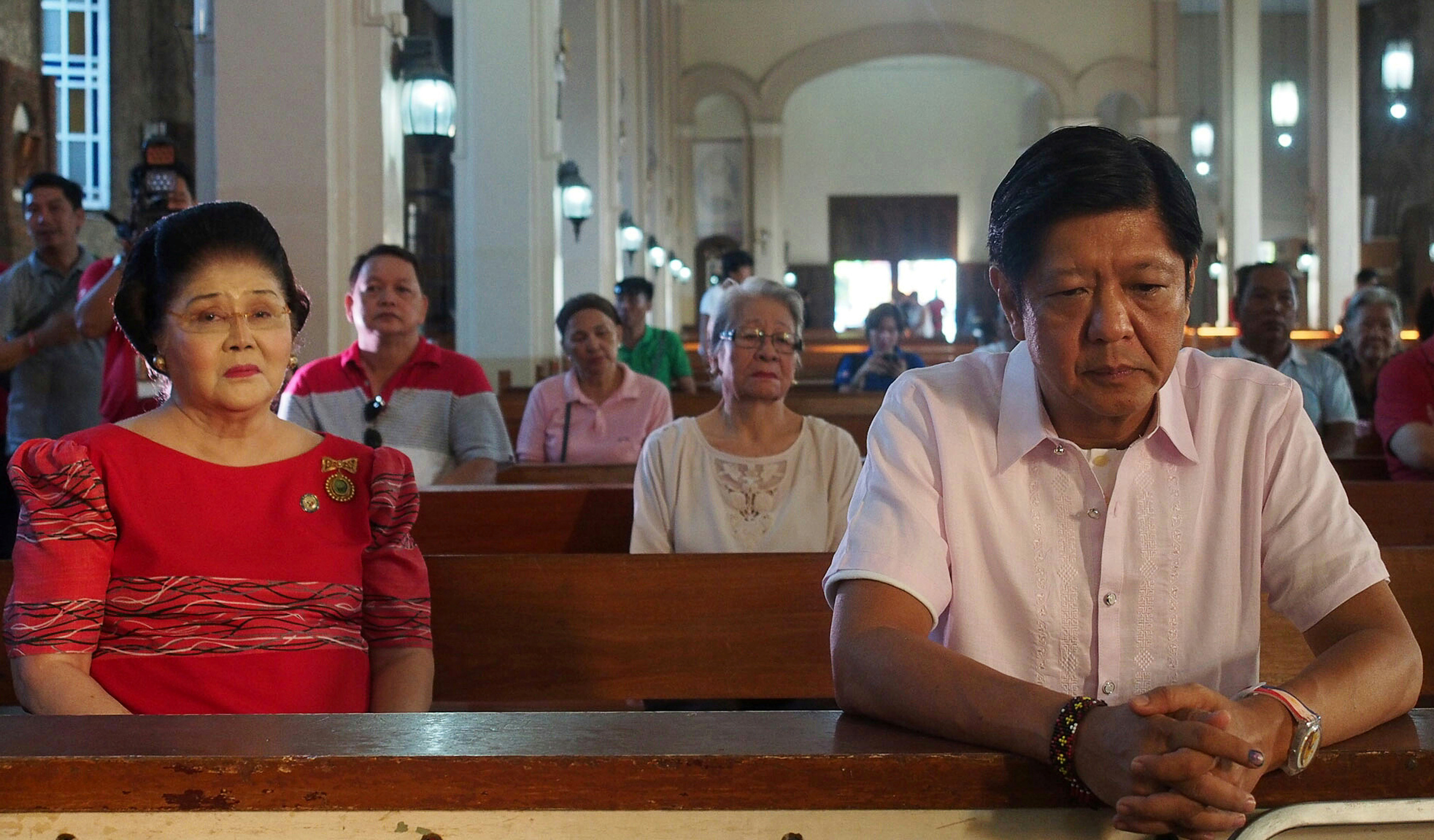 Philippine vice-presidential candidate Ferdinand  Bongbong  Marcos, attends a mass with his mother, former First Lady Imelda Marcos, in the Philippine town of Batac, in Ilocos Norte province, on May 9, 2016
