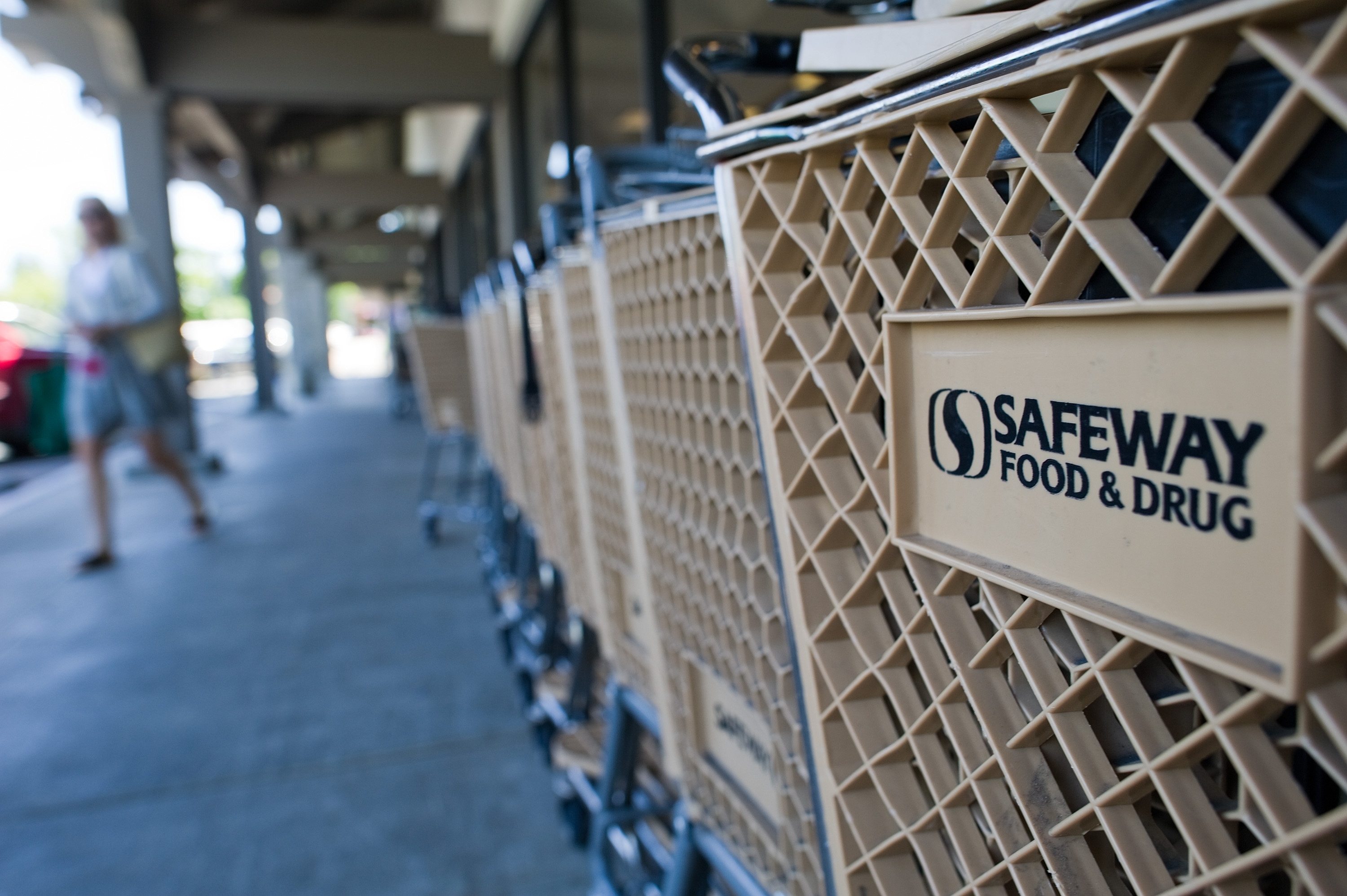 The Safeway Inc. logo is displayed on shopping carts outside of a Safeway store in Alamo, California.