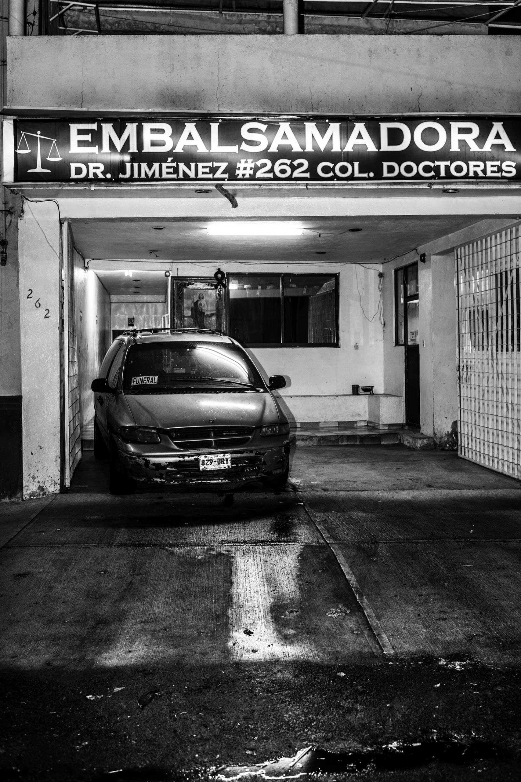 The entrance of the Embalsamadoras Funeral Office in the Colonia Doctores neighborhood in Mexico City. It usually handles between three and 15 corpses a night. March 9, 2016.