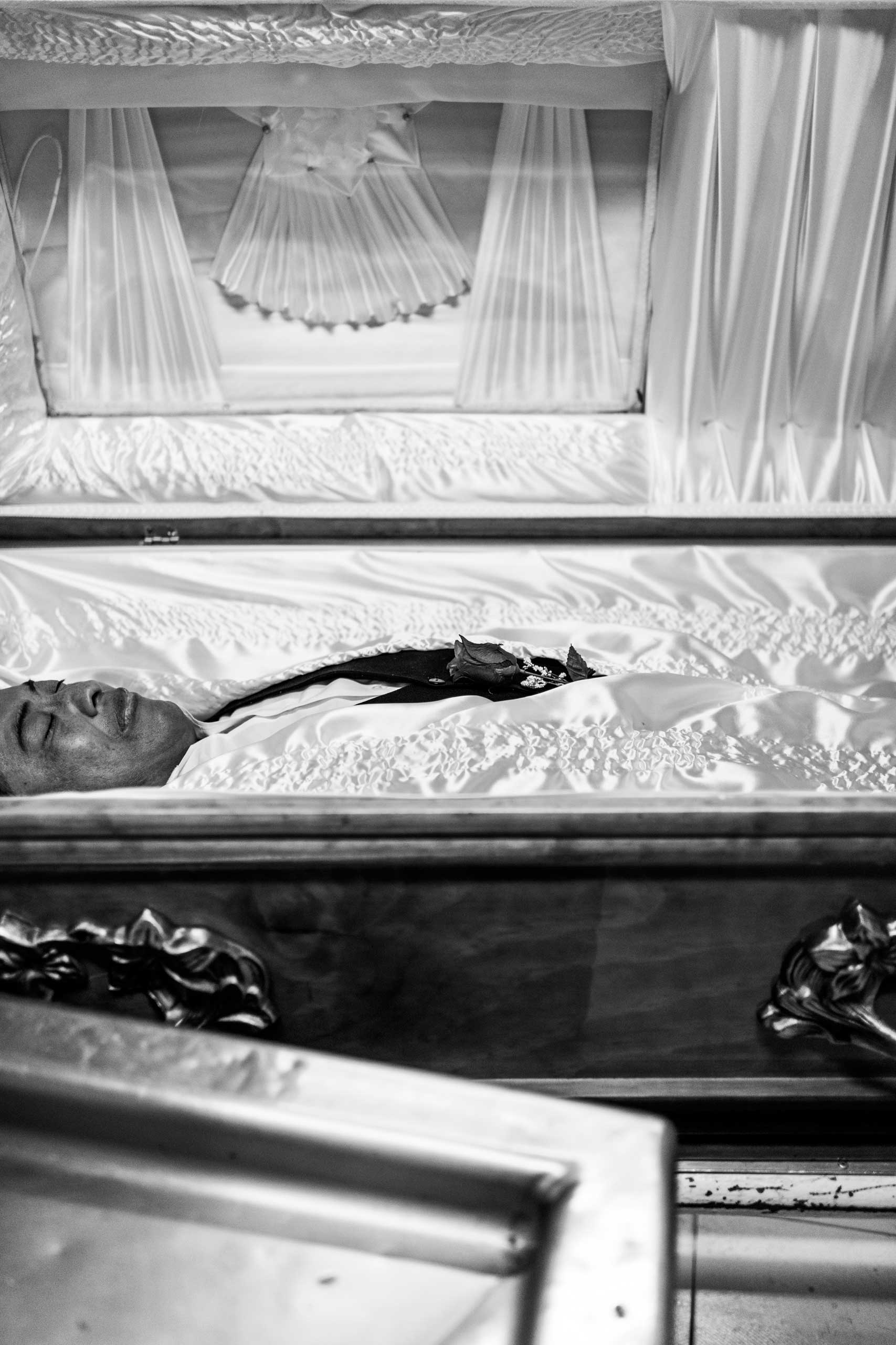 A body is prepared and placed in a coffin. March 21, 2016.