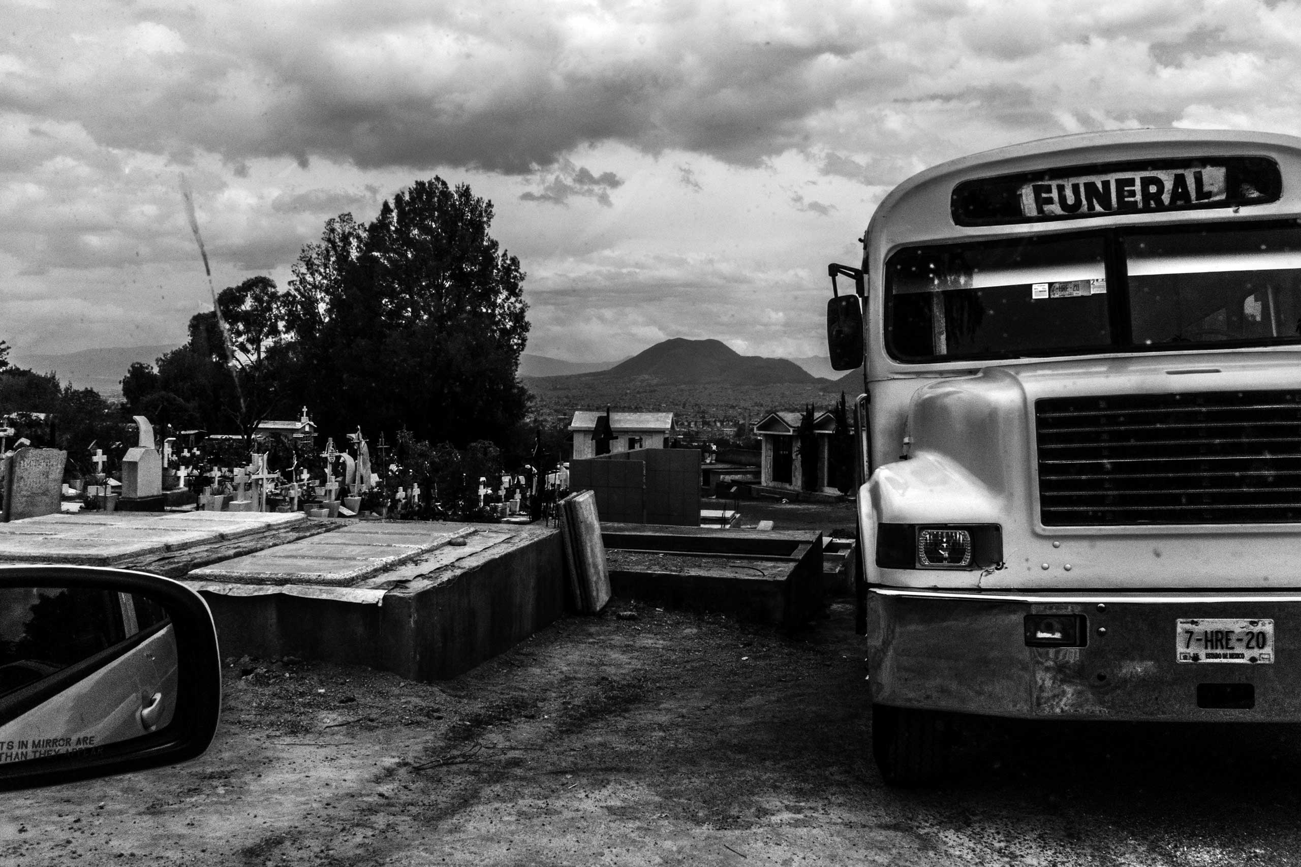 A funeral bus is seen at the San Nicolas Tolentino cemetery. For practical purposes, families and friends usually rent a bus to attend a funeral. March 17, 2016.