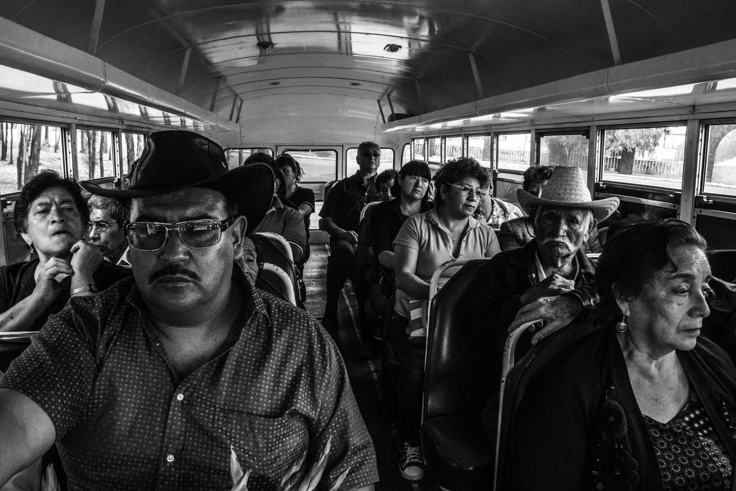 A family on a bus at the San Lorenzo Tezonco cemetery. March 17, 2016.