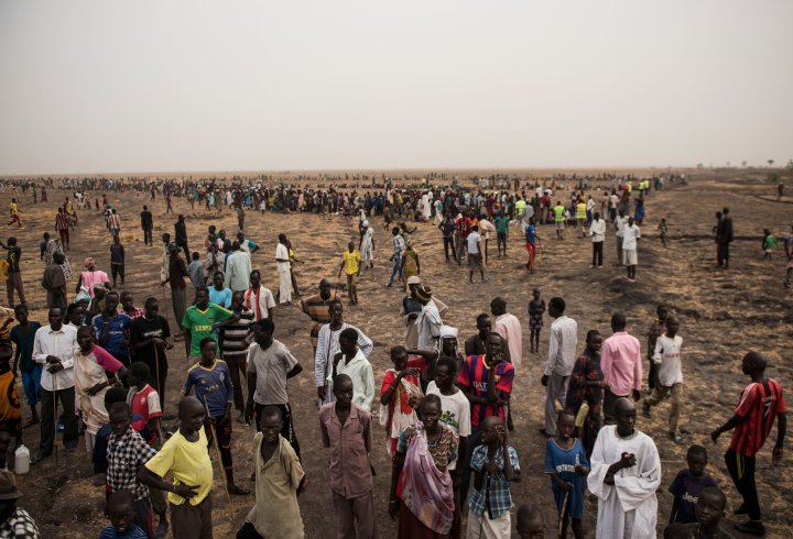 Tens of thousands of South Sudanese line up for food handouts on March 17. The fighting has left many in the country starving