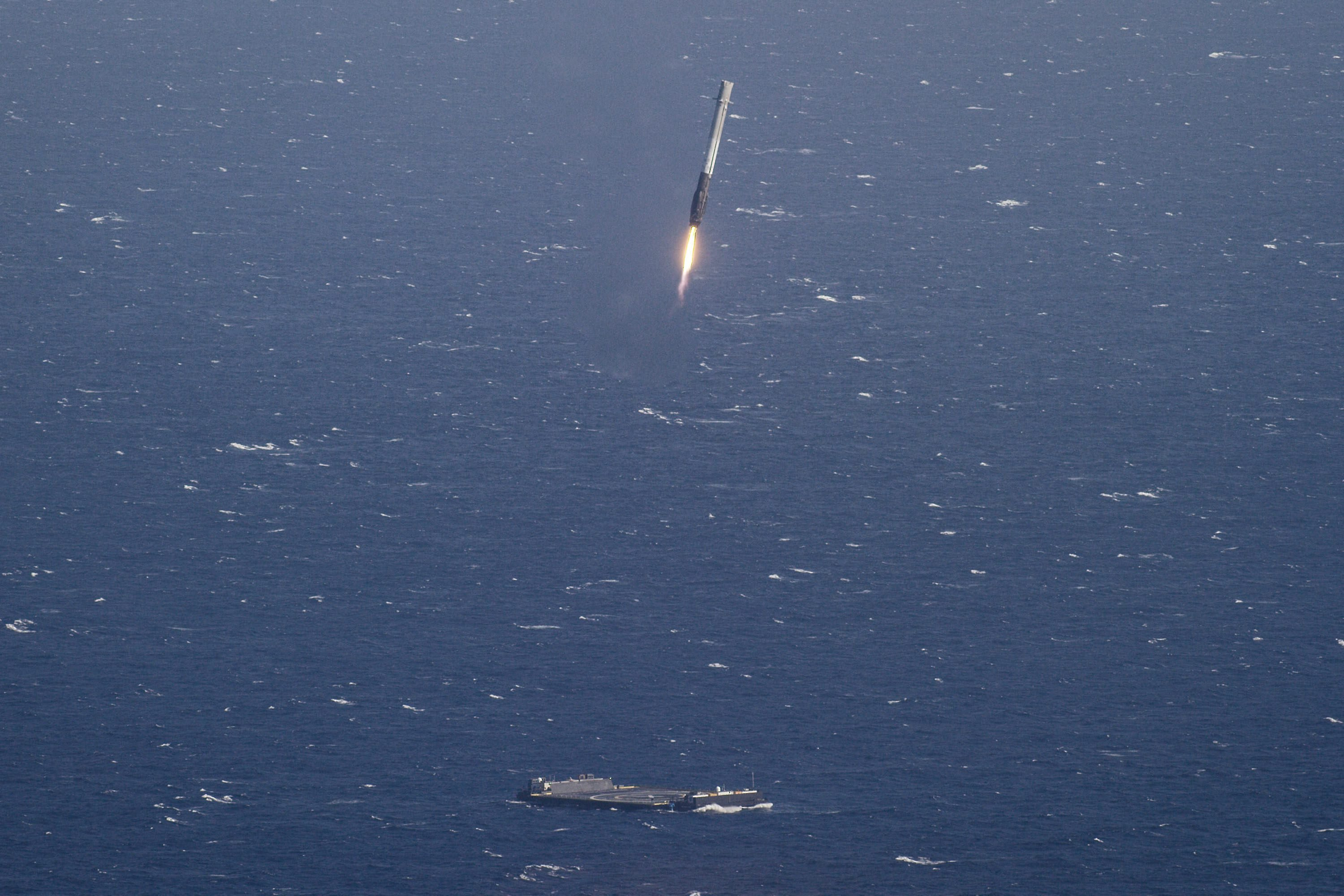 A SpaceX Falcon 9 rocket landing on a platform at sea in the Atlantic Ocean, on April 9, 2016.