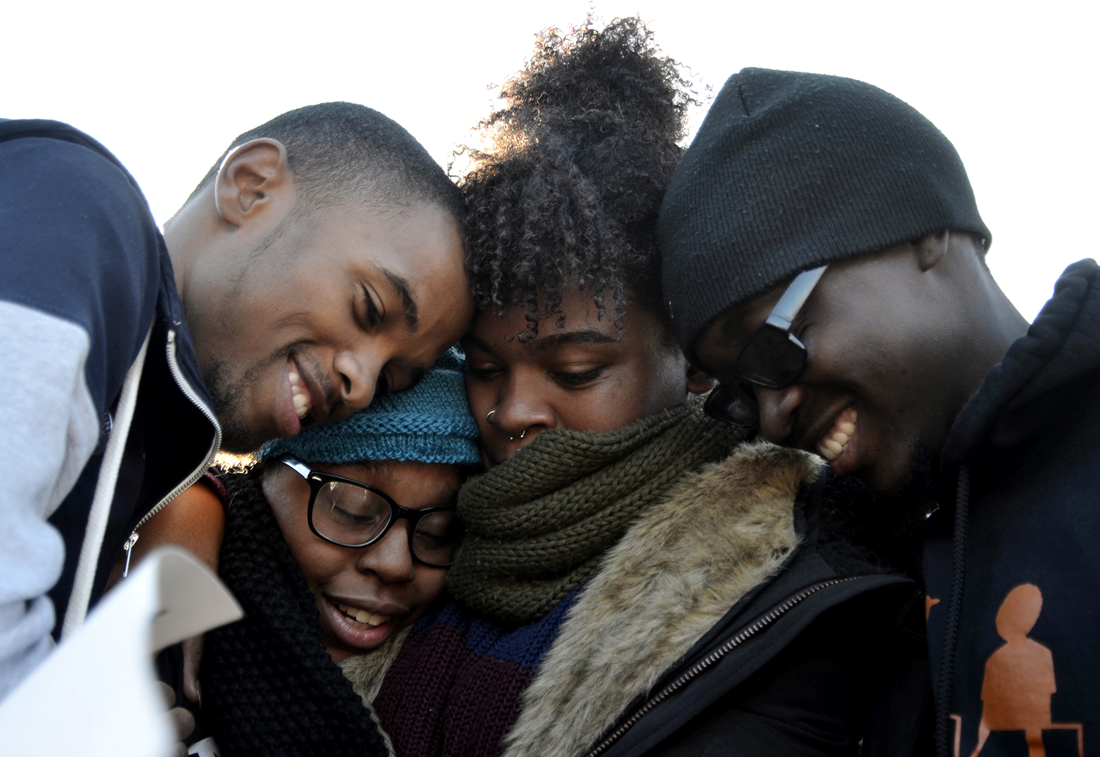 Members of Concerned Student 1950 embrace after the announcement that University of Missouri System President Tim Wolfe would resign Nov. 9, 2015, in Columbia, Mo.
