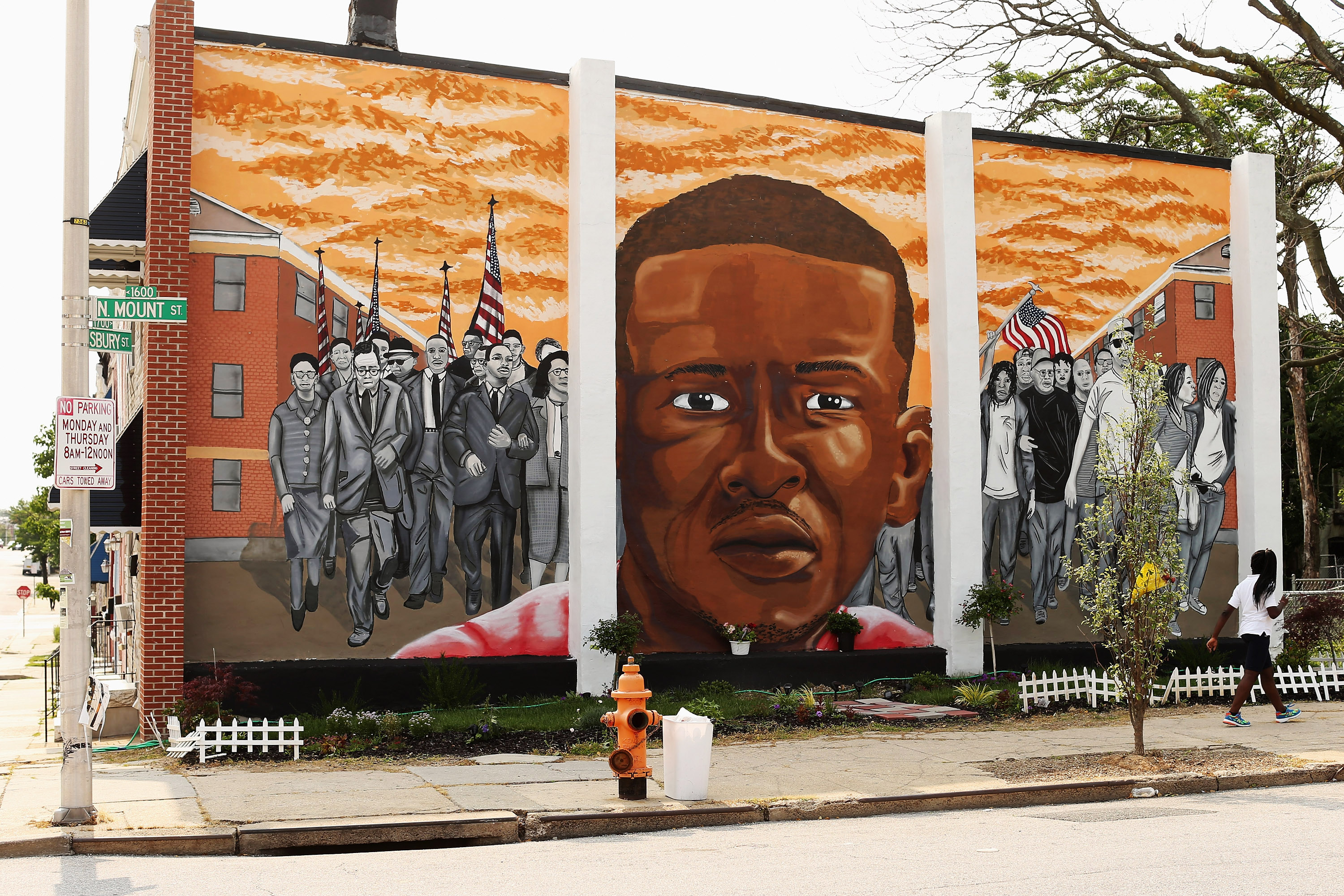 A mural memorializing Baltimore resident Freddie Gray is painted on the wall near the place where he was arrested by police at the Gilmor Homes housing project June 9, 2015 in Baltimore.
