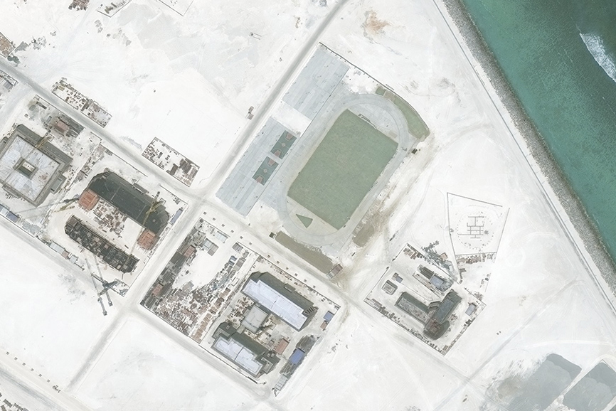 A satellite image of Subi Reef, captured by DigitalGlobe on May 1, 2016, shows the beginnings of a running track and basketball courts.