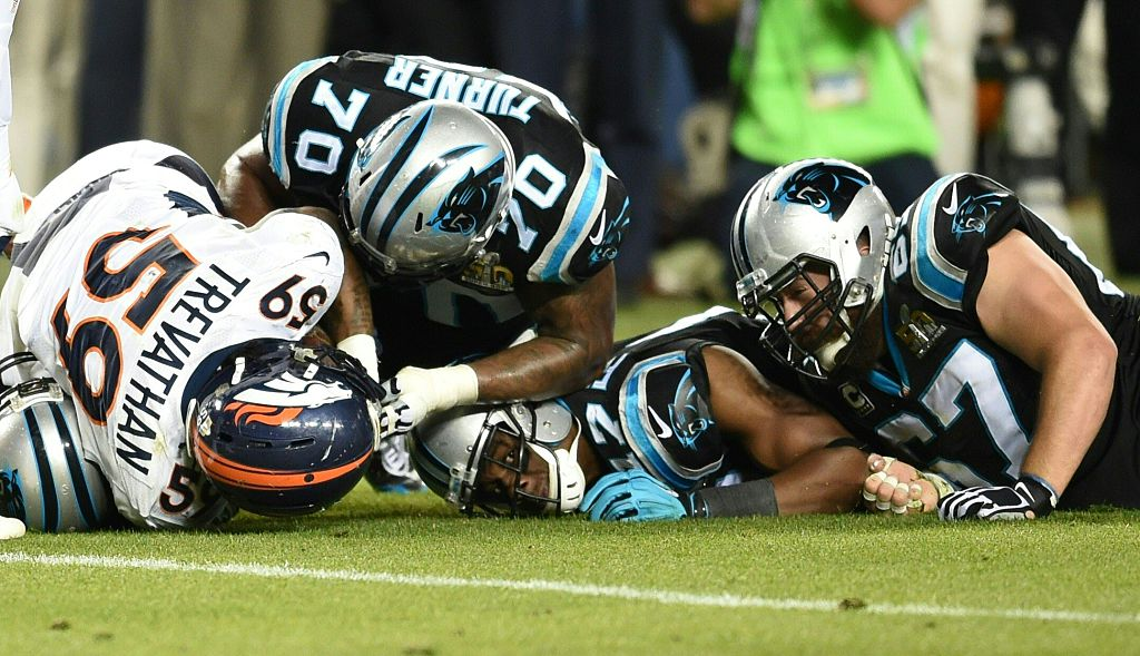 Denver Broncos and Carolina Panthers fight for the ball during Super Bowl 50 at Levi's Stadium in Santa Clara, California, on February 7, 2016.