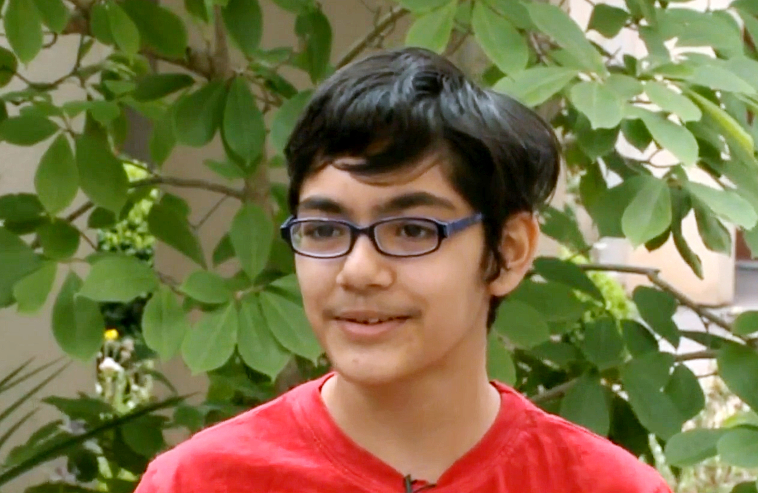 Tanishq Abraham, 12, talks about his recent graduation from community college and beginning his university education this fall, in an interview with KOVR-TV at American River College in Sacramento, Calif.