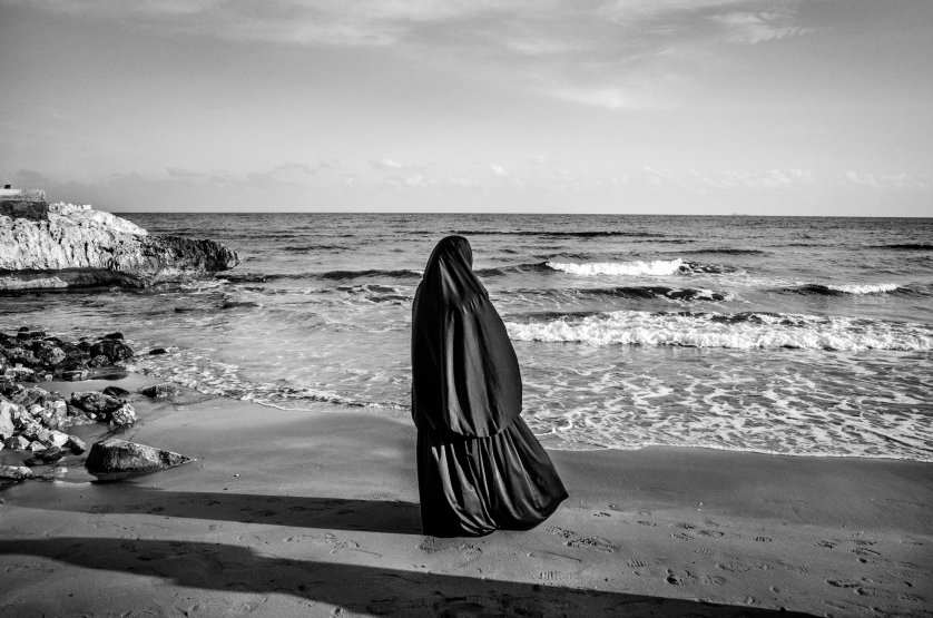 A Syrian woman looks at the sea in Kizkalesi, Turkey, while waiting to board a ship heading further north in Europe, Jan. 29, 2015. More than 3,000 refugees and migrants drowned in the Mediterranean in 2014 fleeing conflict-torn regions, and more than 3,700 died in 2015.