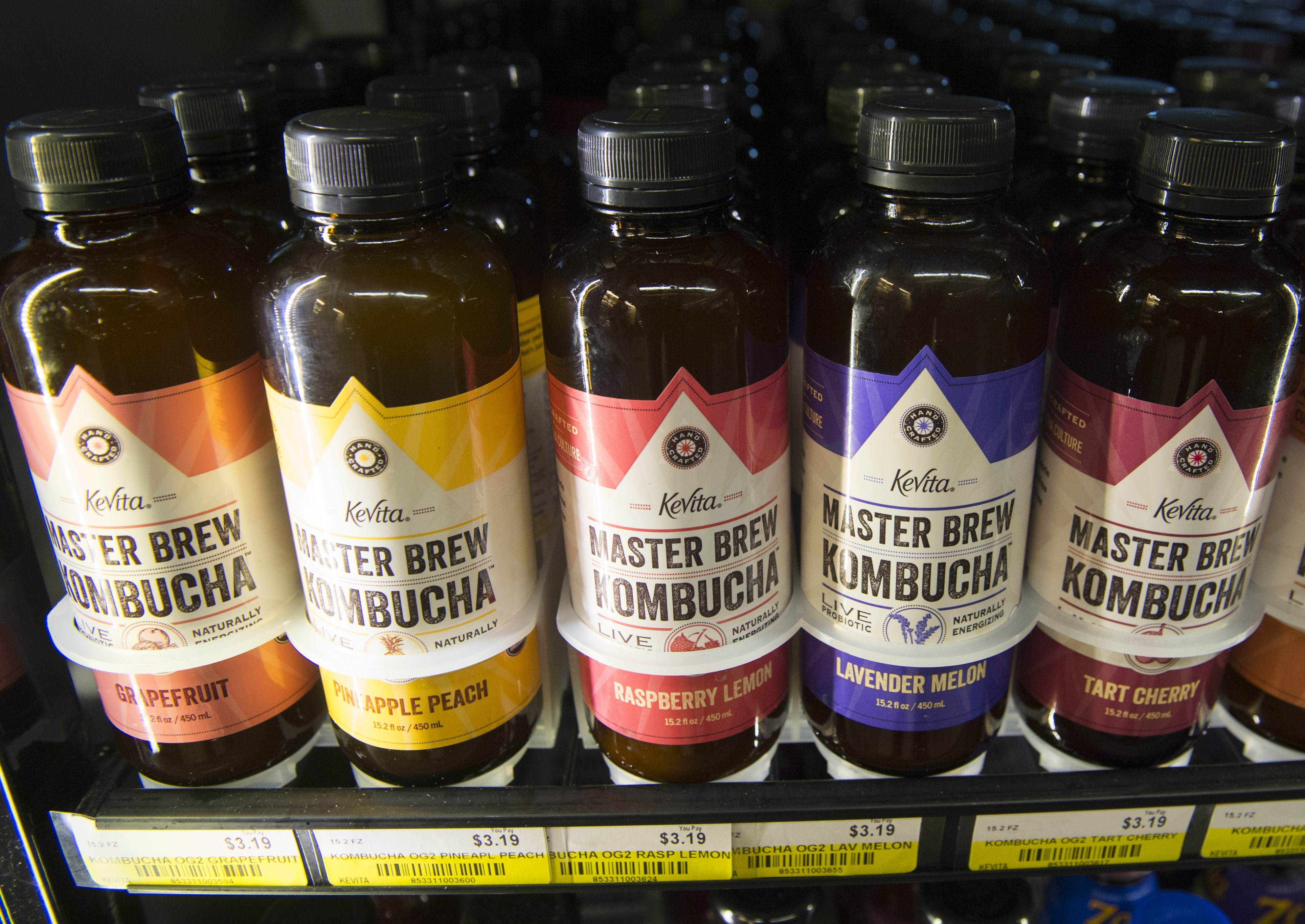 Bottles of kombucha, a fermented tea that originated in China, are seen for sale at a store in Washington, DC, August 12, 2015.