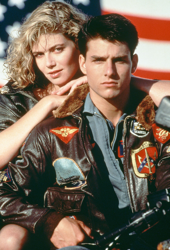 American actors Tom Cruise, as Lieutenant Pete 'Maverick' Mitchell, and Kelly McGillis, as Charlotte 'Charlie' Blackwood, in a promotional portrait for 'Top Gun', directed by Tony Scott, 1986.