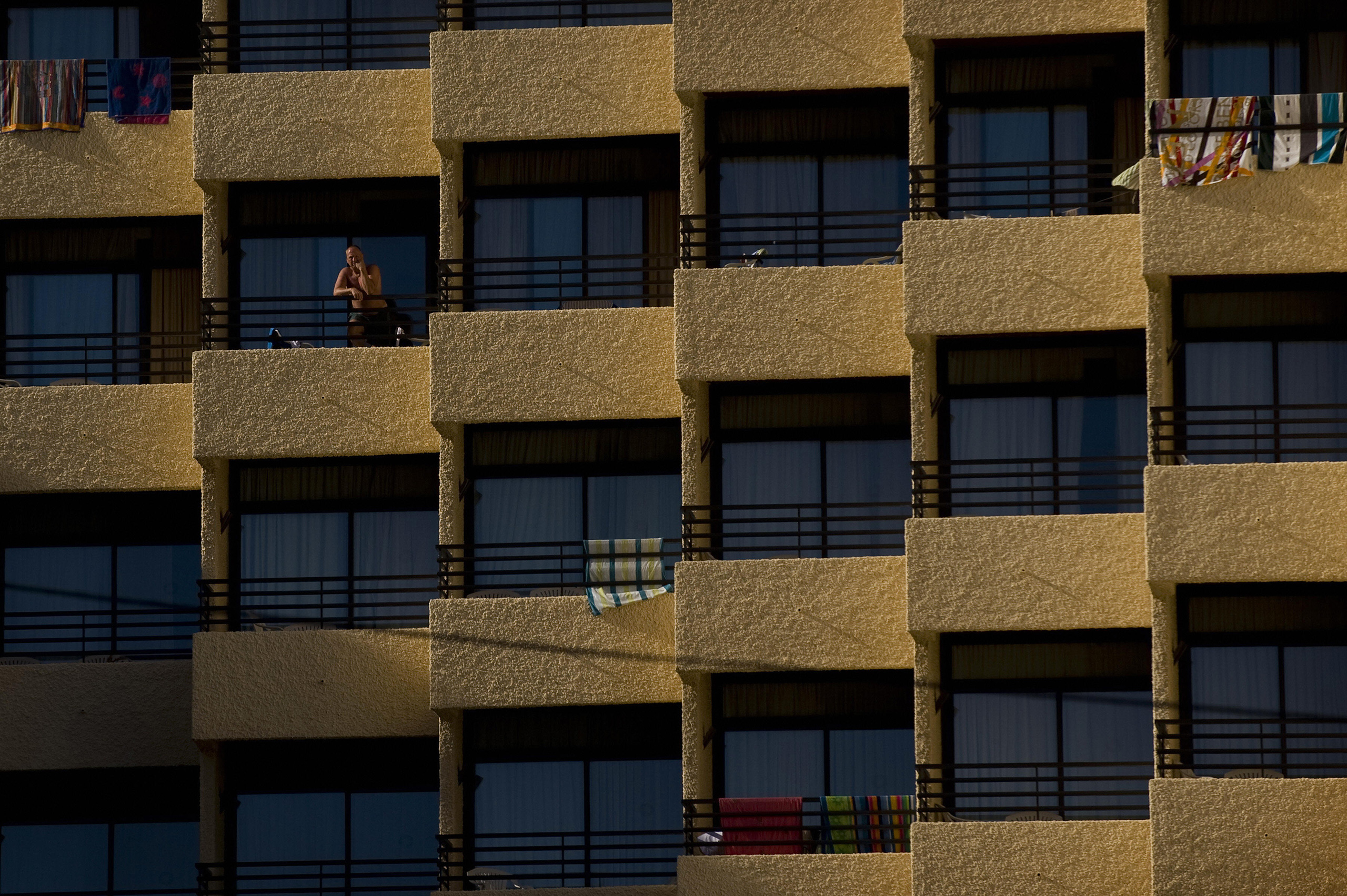 A man stands on the terrace of a hotel in Torremolinos, southern Spain, Aug. 3, 2009.