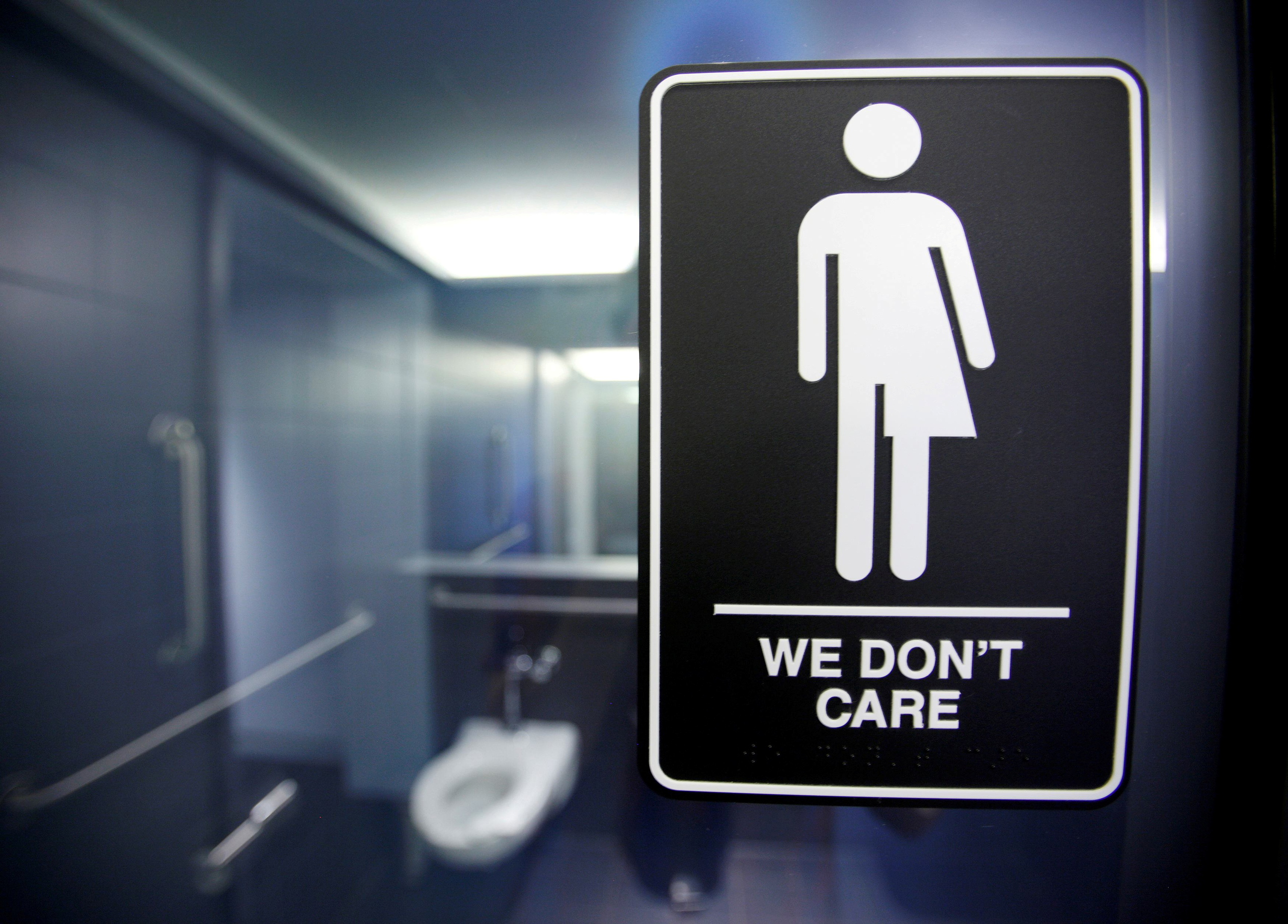 A sign protesting a recent North Carolina law restricting transgender bathroom access is seen in the bathroom stalls at the 21C Museum Hotel in Durham, N.C on May 3, 2016.