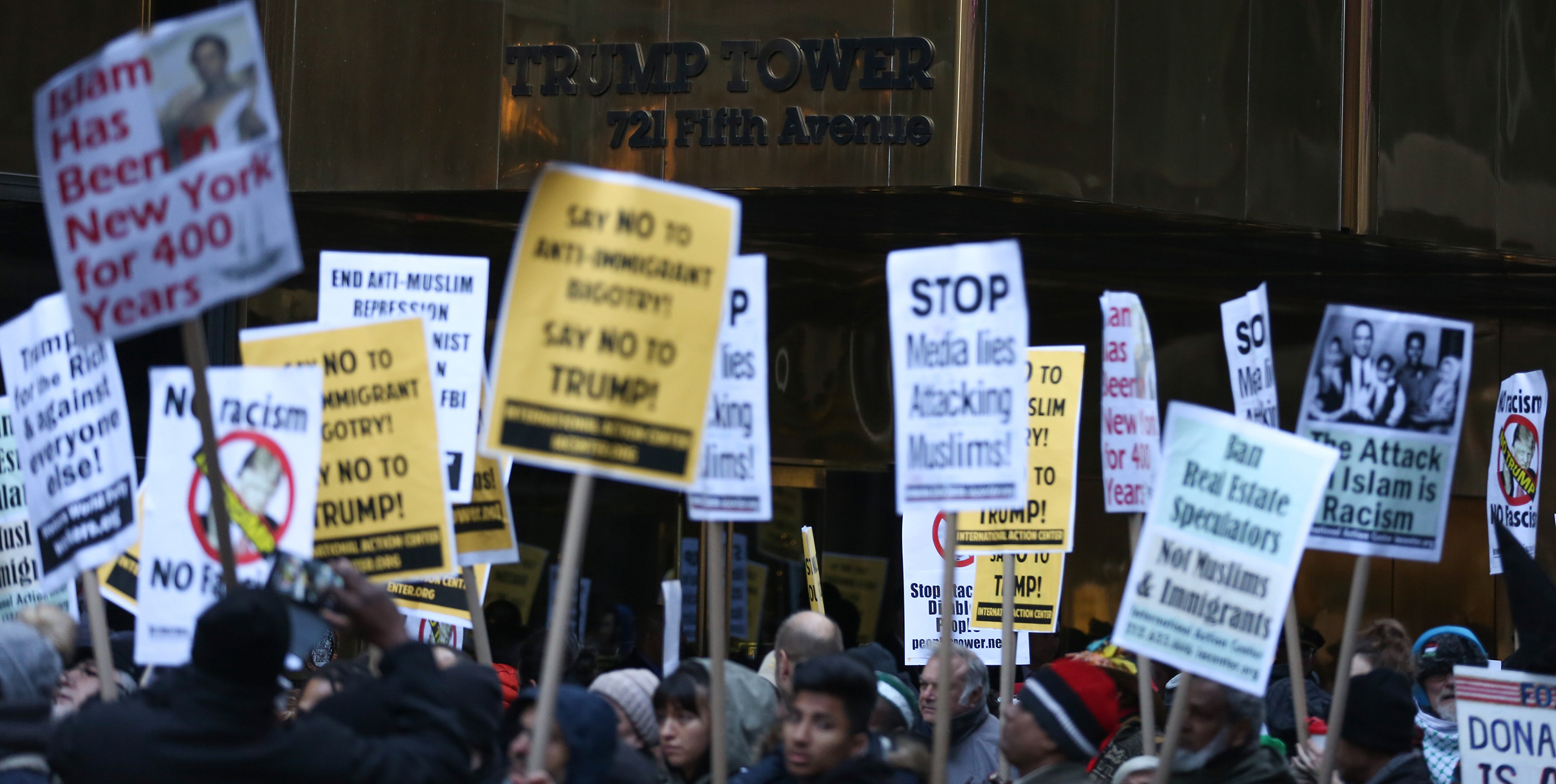 People stage a protest against Donald Trump after he made comments stating that he wants a 'total and complete shutdown of Muslims entering the United States' in front of the Trump Tower at 5th Avenue in New York City on Dec. 20, 2015.