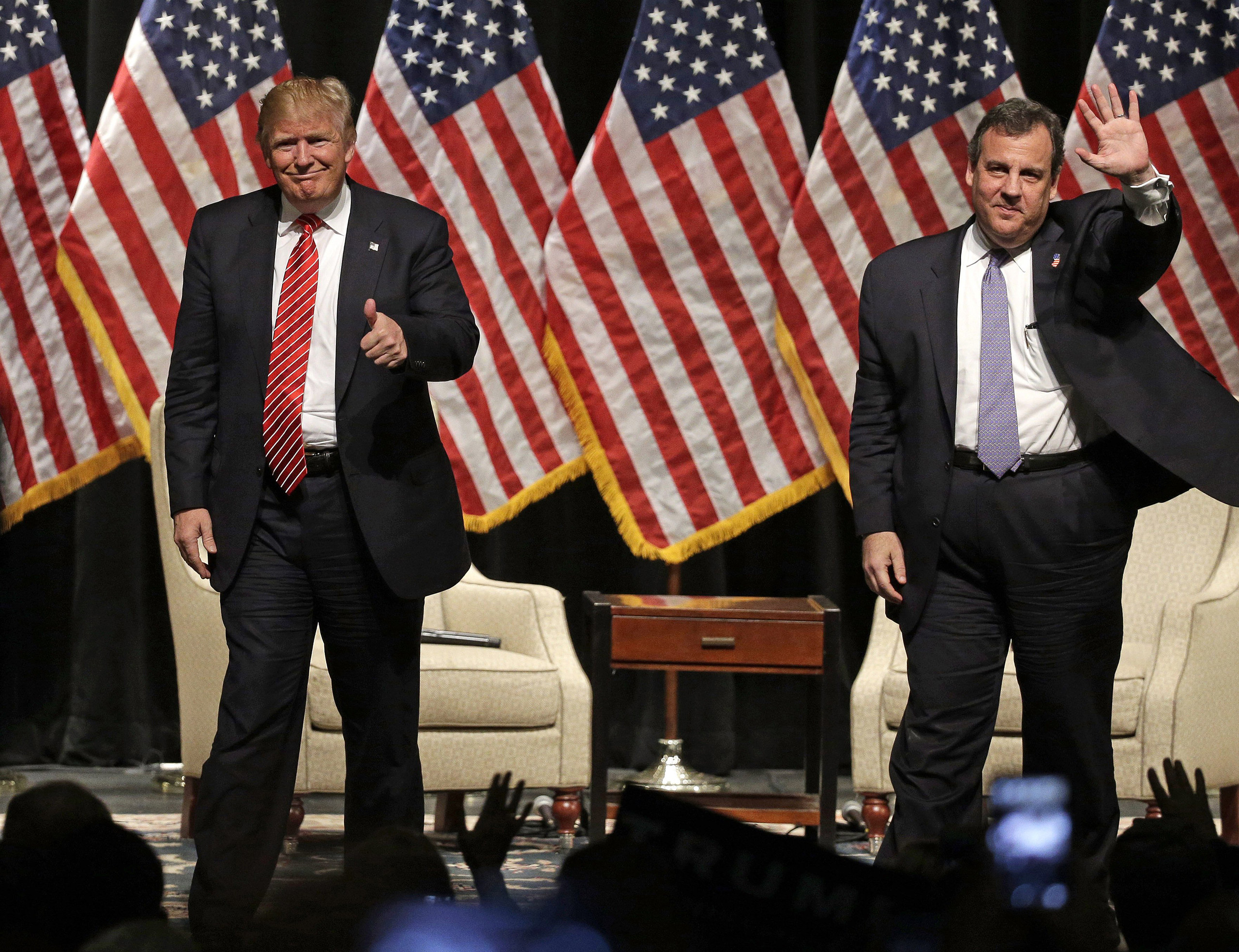 Donald Trump gives a thumbs up as New Jersey Gov. Chris Christie waves to the crowd as they walk off the stage after a rally at Lenoir-Rhyne University in Hickory, N.C., March 14, 2016.