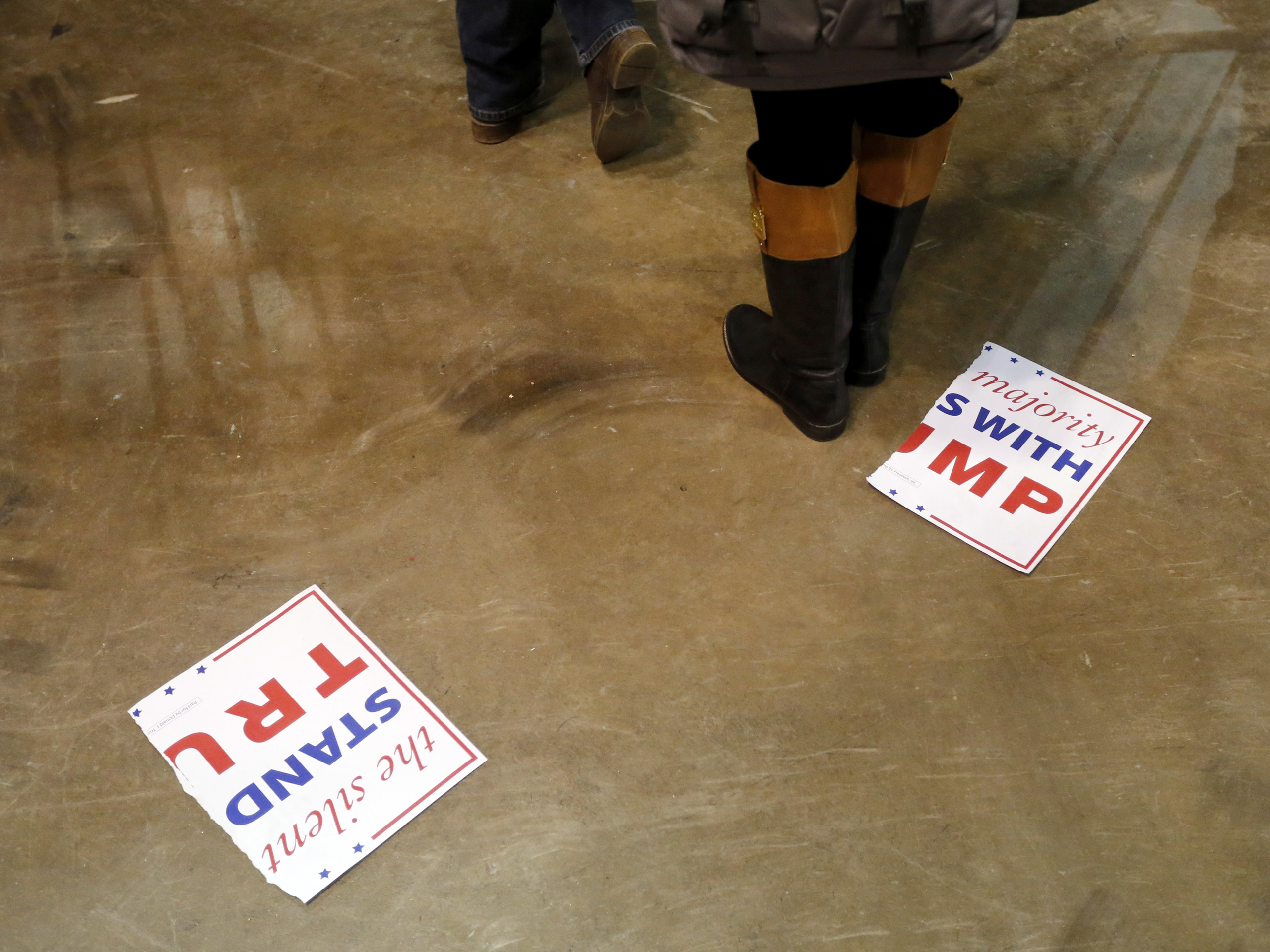 A torn campaign sign lays on the floor after a rally for Trump was canceled due to security concerns at the University of Illinois-Chicago in Chicago on March 11, 2016.
