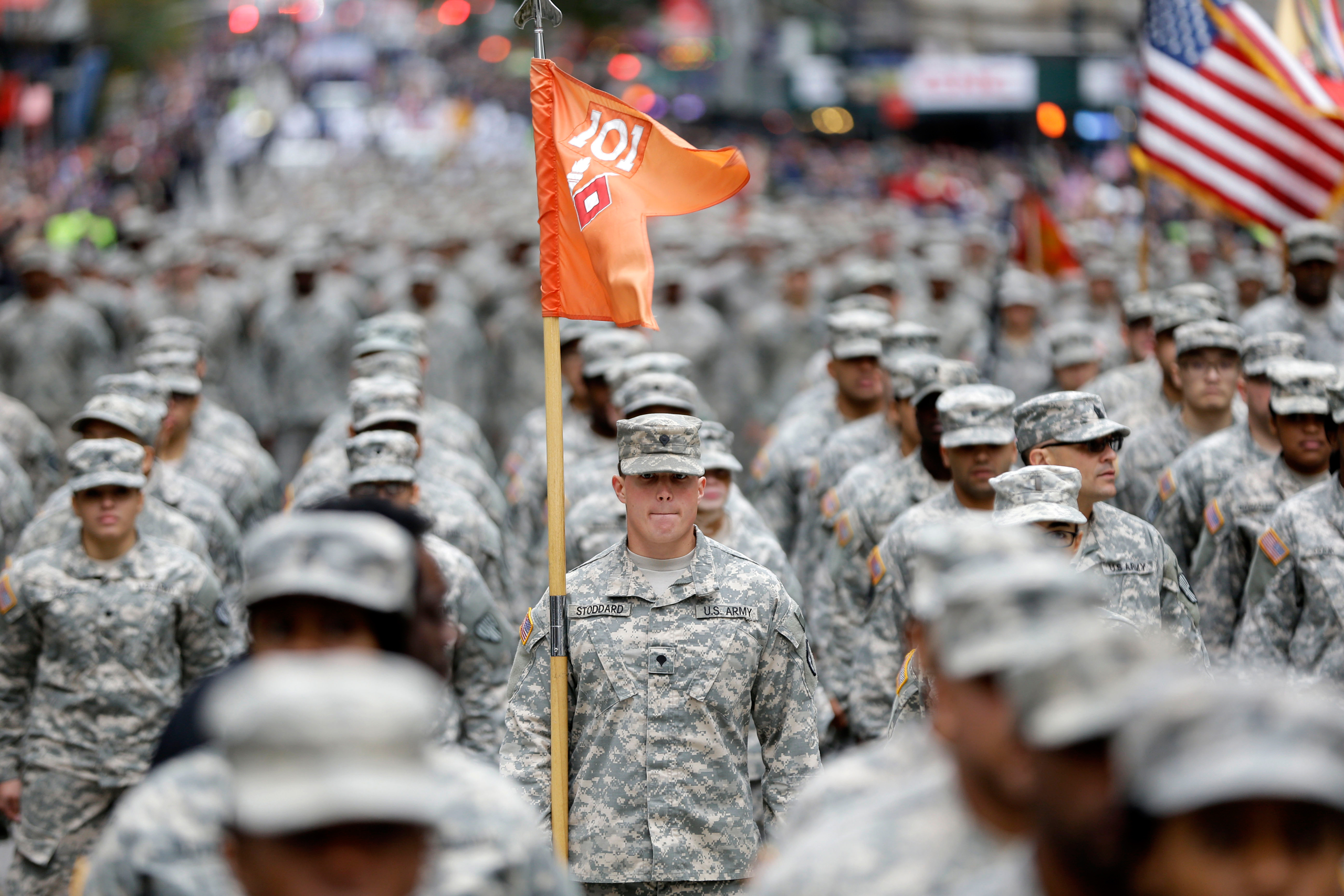 Military personnel march in the annual Veteran's Day parade in New York on Nov. 11, 2015.