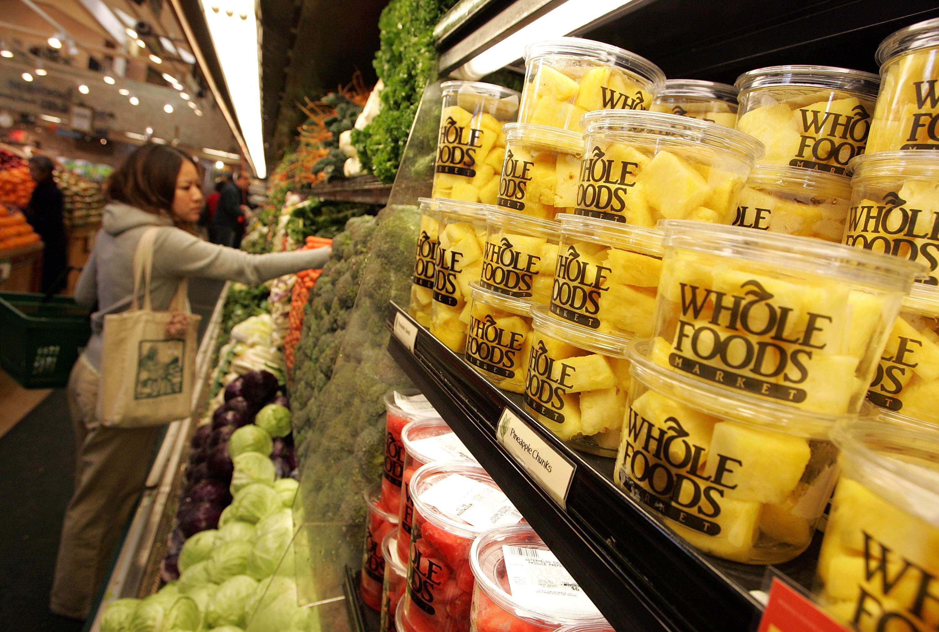 A customer shops for produce at a Whole Foods Market February 22, 2007 in San Francisco, California.