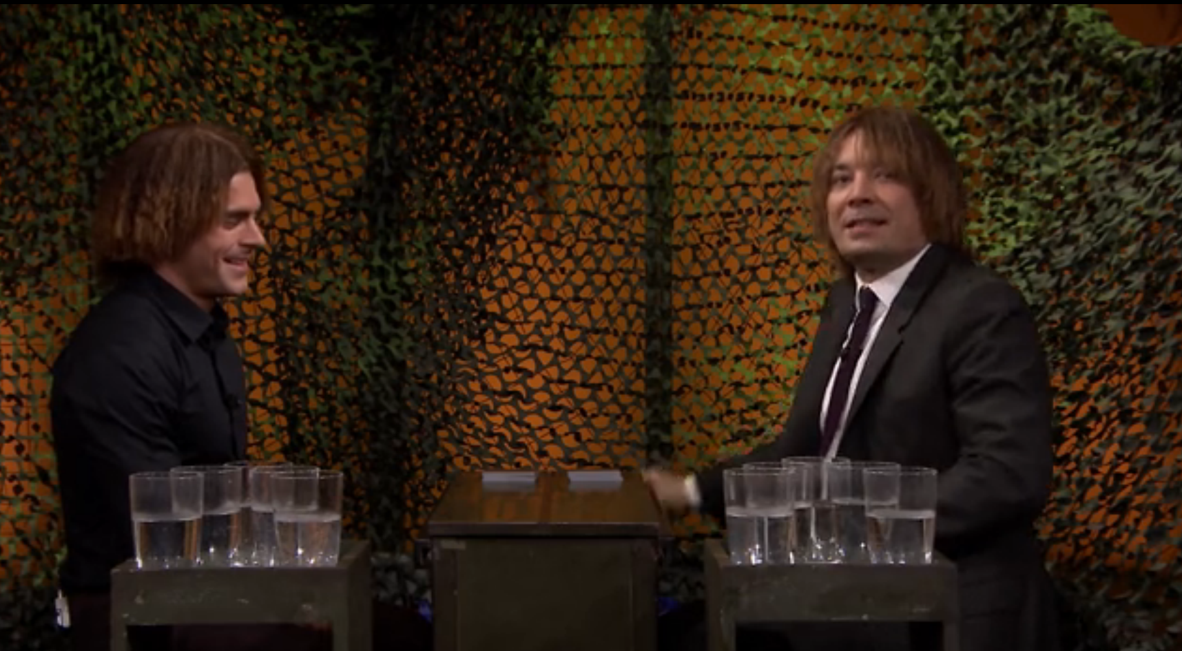 Jimmy and Zac Efron face off in a twist on the card game War, where the loser of each hand faces wet consequences on The Tonight Show Starring Jimmy Fallon on May 18, 2016.