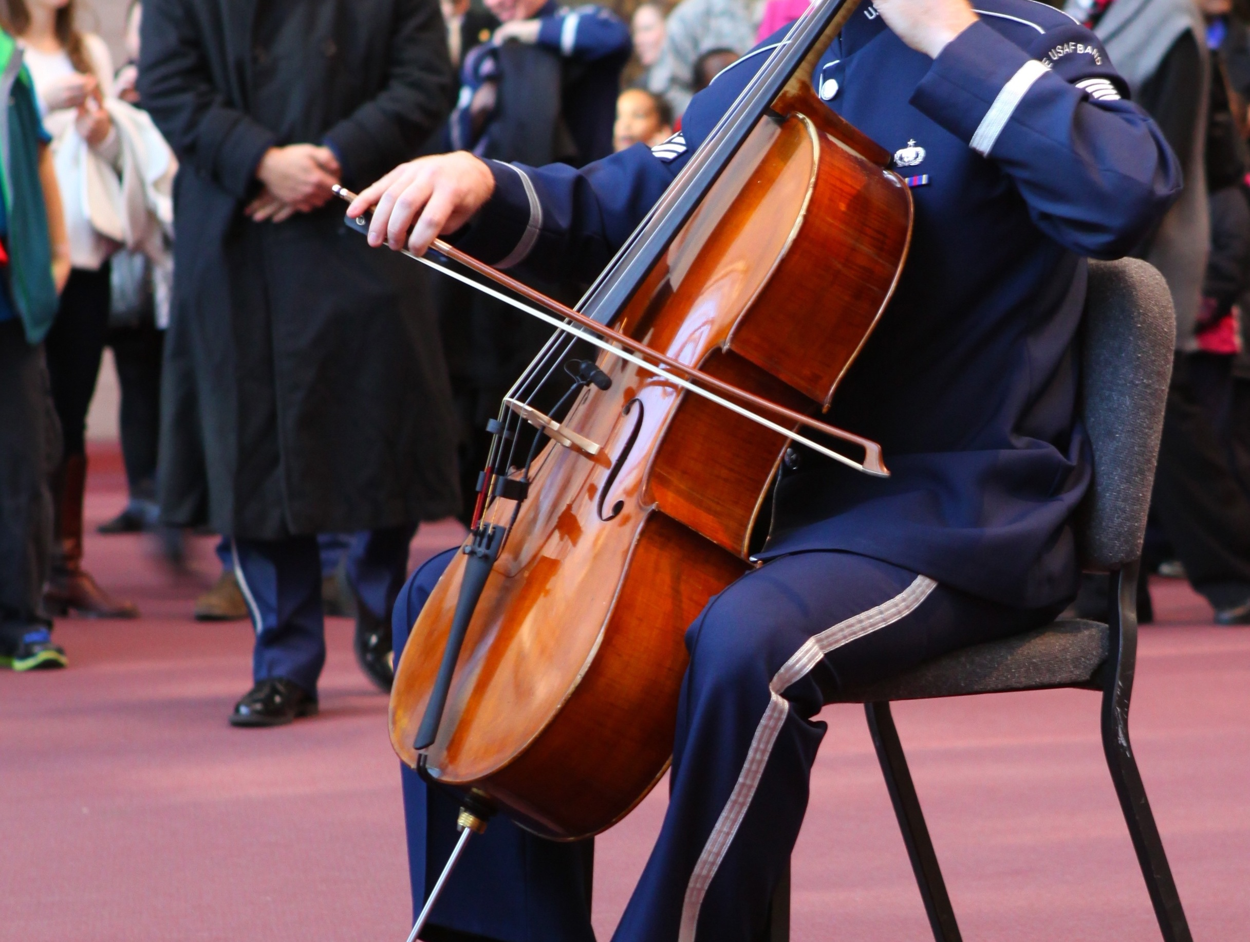A member of the Air Force Band plays a cello.