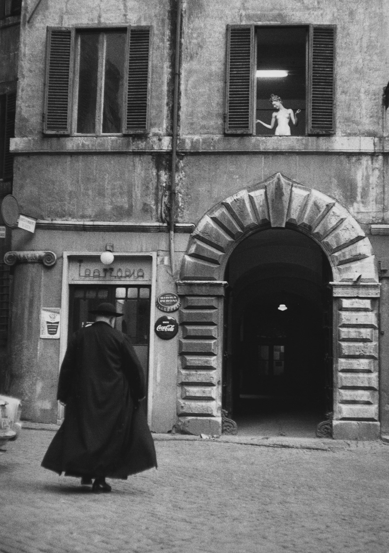 Priest in front of trattoria, Rome, 1957.
