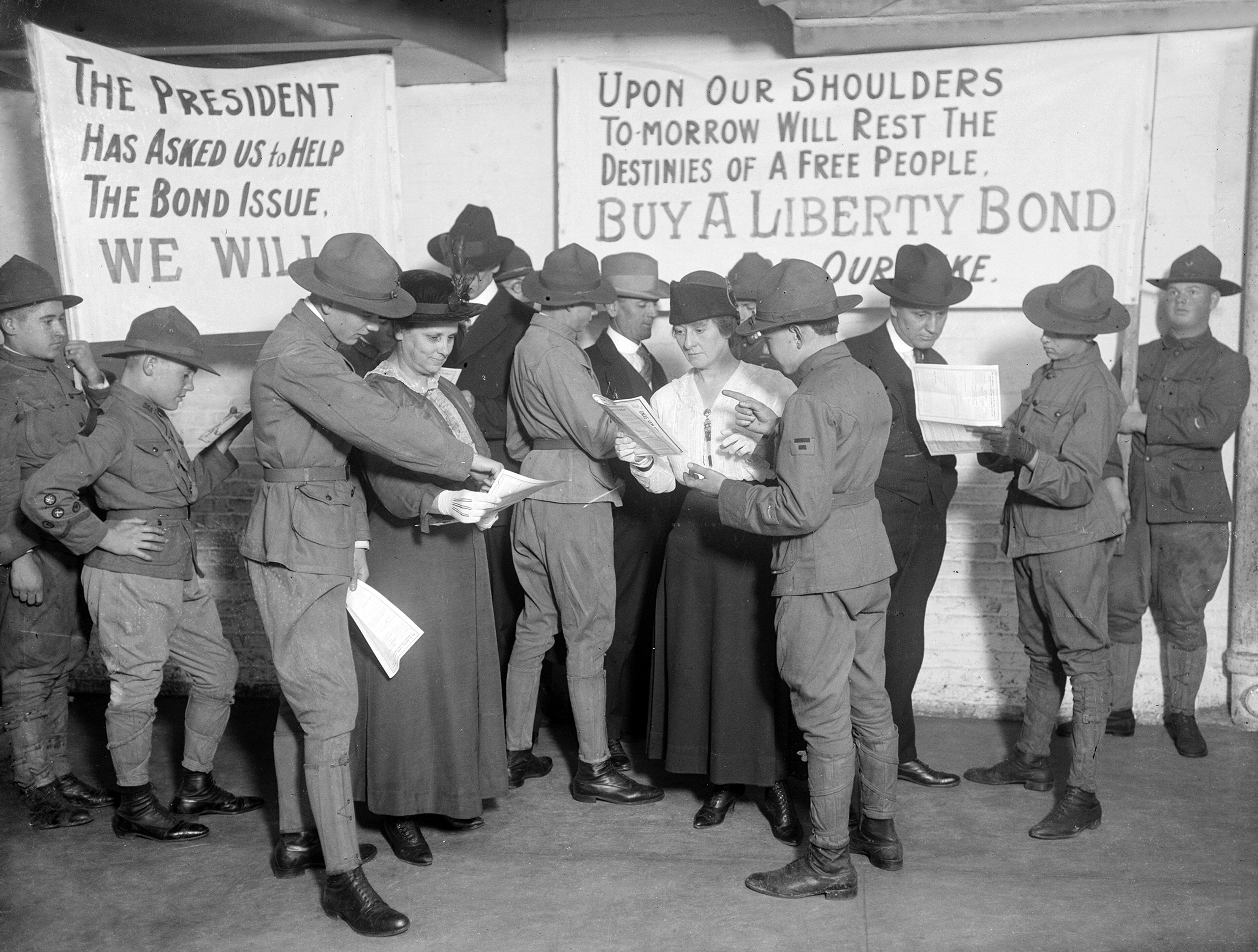 Boy scouts wearing U.S. Army uniforms sell Liberty Bonds in Chicago, Ill., 1917.