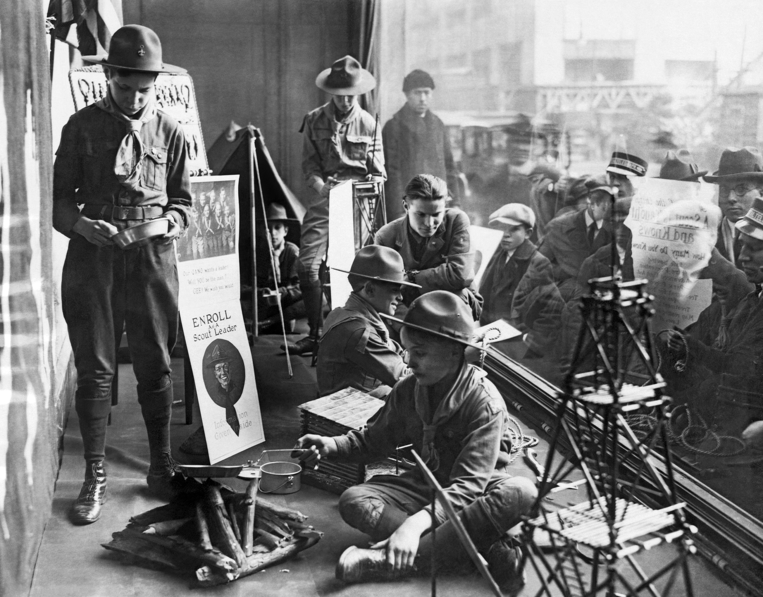 Boy Scouts camped out in the store window of Abercrombie and Fitch as part of their recruitment drive for new scout members in New York. 1923.