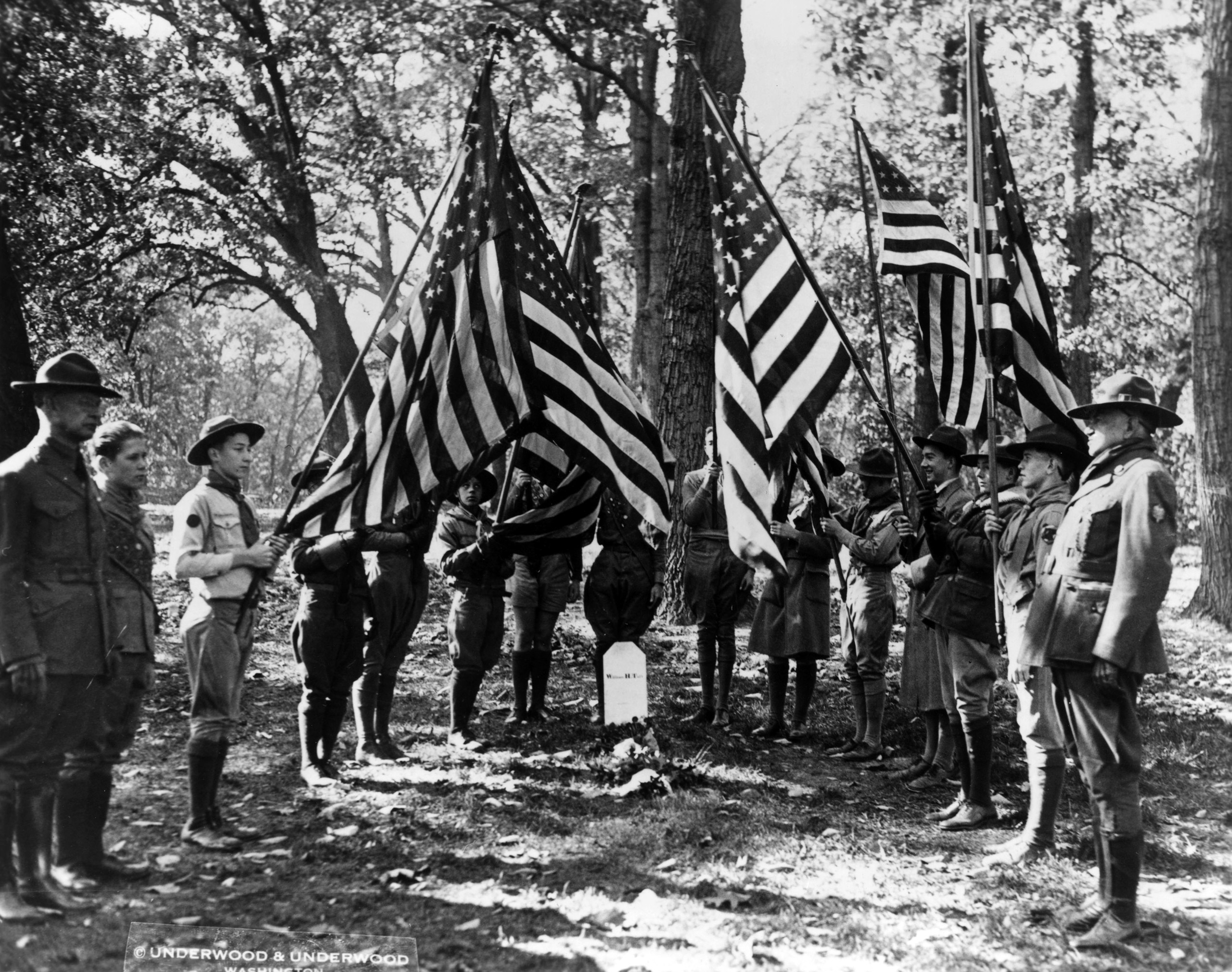 A delegation of boy scouts at the grave of former President William Howard Taft in Arlington National Cemetery, Washington D.C., six months after his death. 1930.