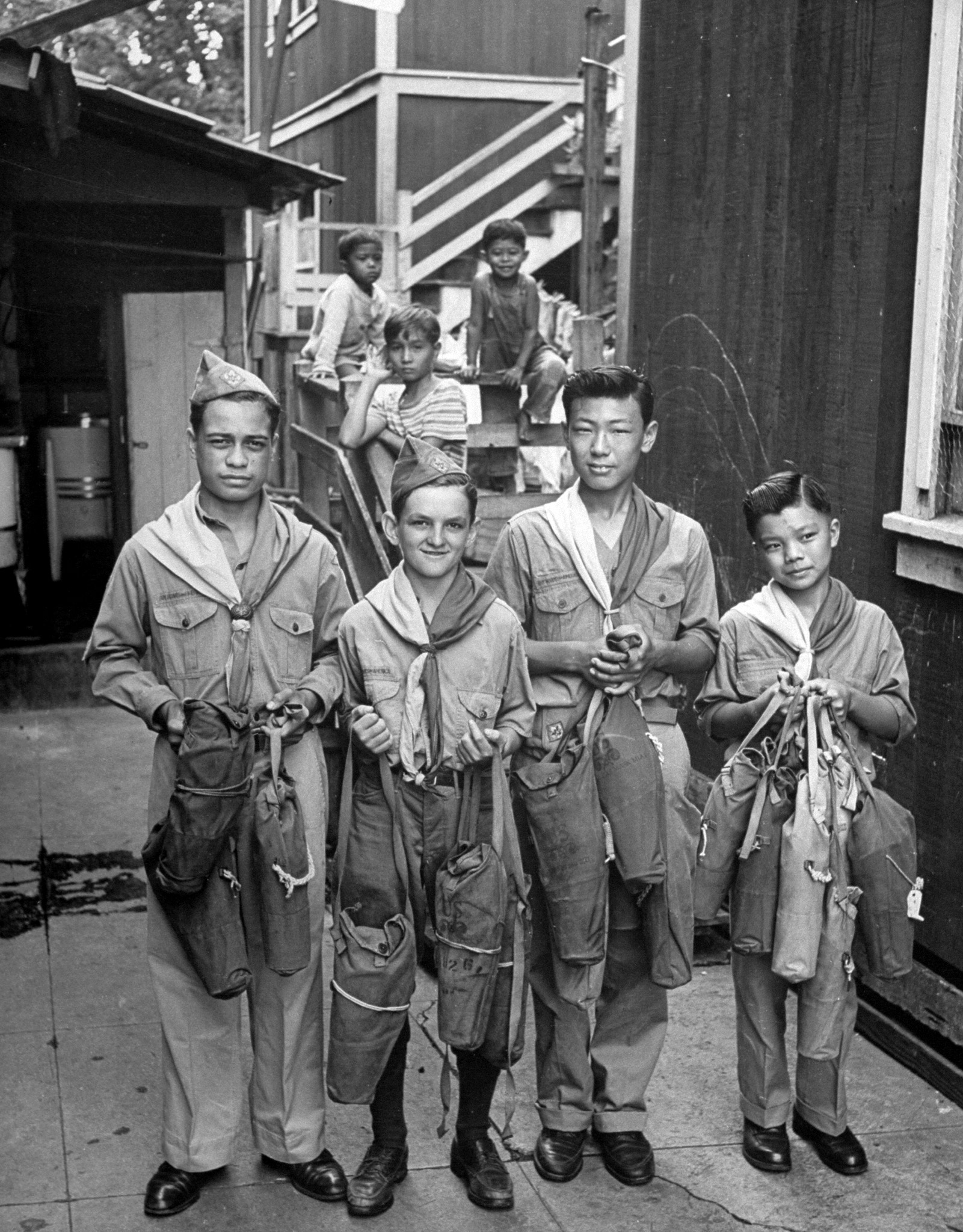 Boy Scouts collecting gas masks at a salvage drive. Hawaii, 1945.
