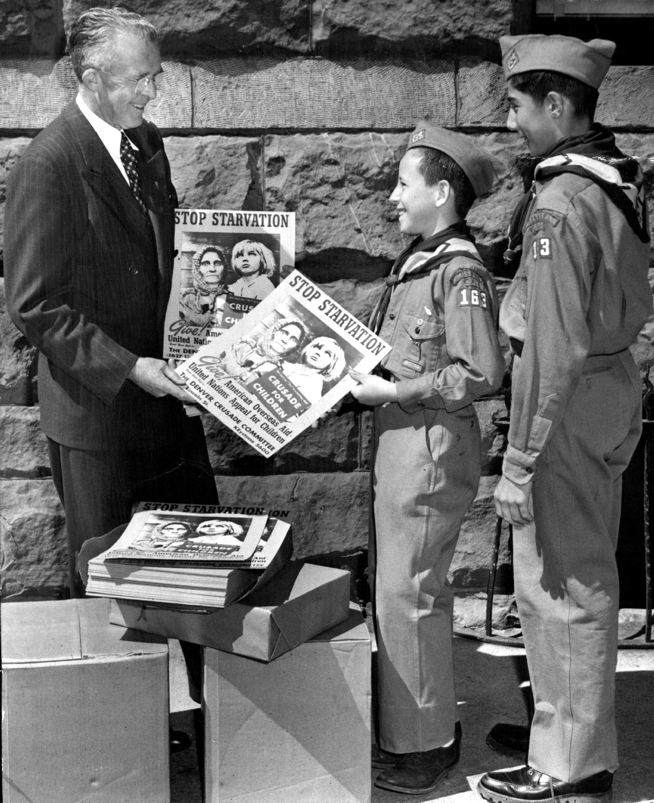Denver Boy Scouts distributing posters to push campaign for aid to 230 million overseas children in desperate need of help. 1948.
