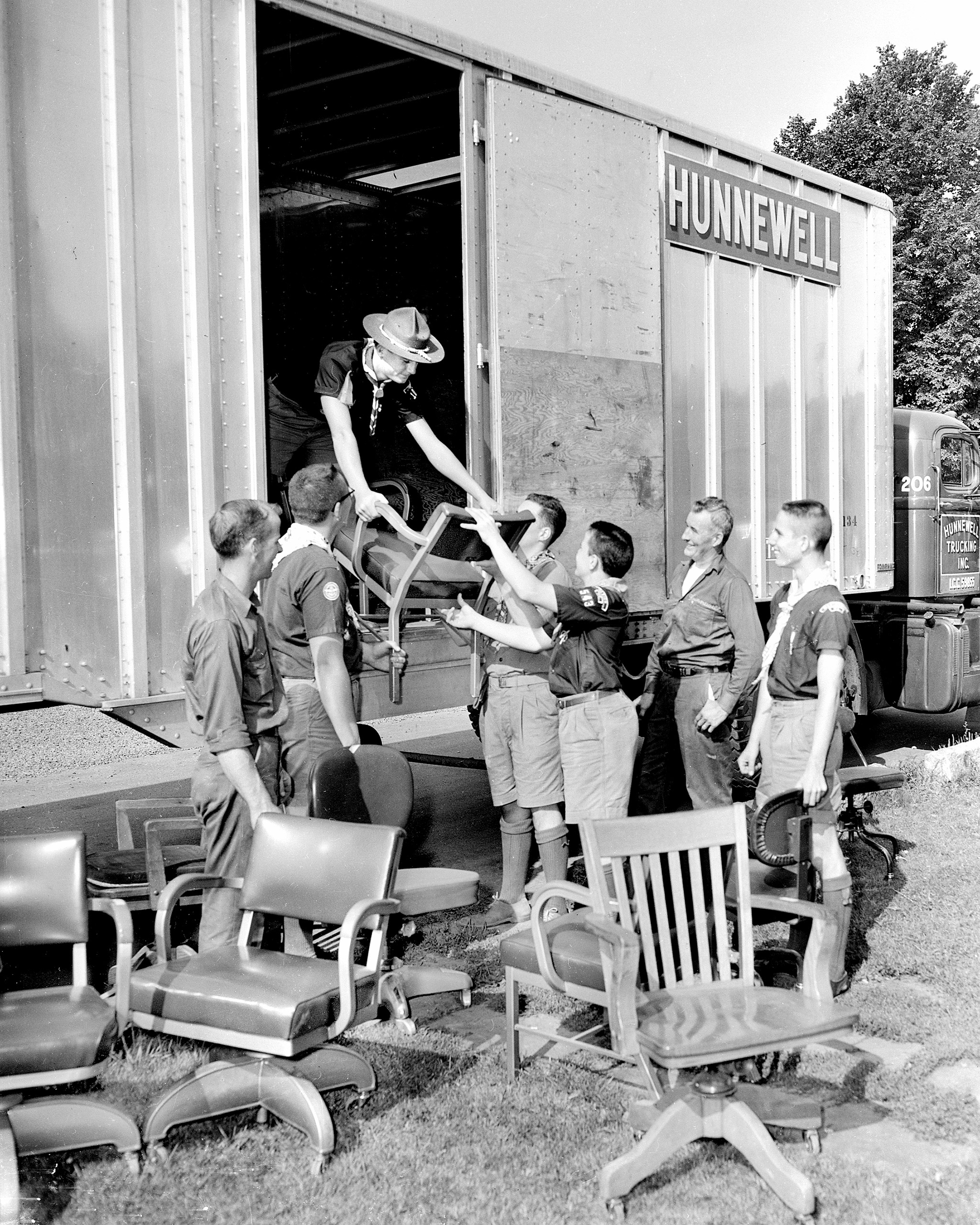 The Pine Tree Council, Boy Scouts of America, moved from Baxter Boulevard to new quarters on Auburn Street with Hunnewell Trucking helping out. Materials were loaded and unloaded by scouts and Hunnewell drivers. 1959.