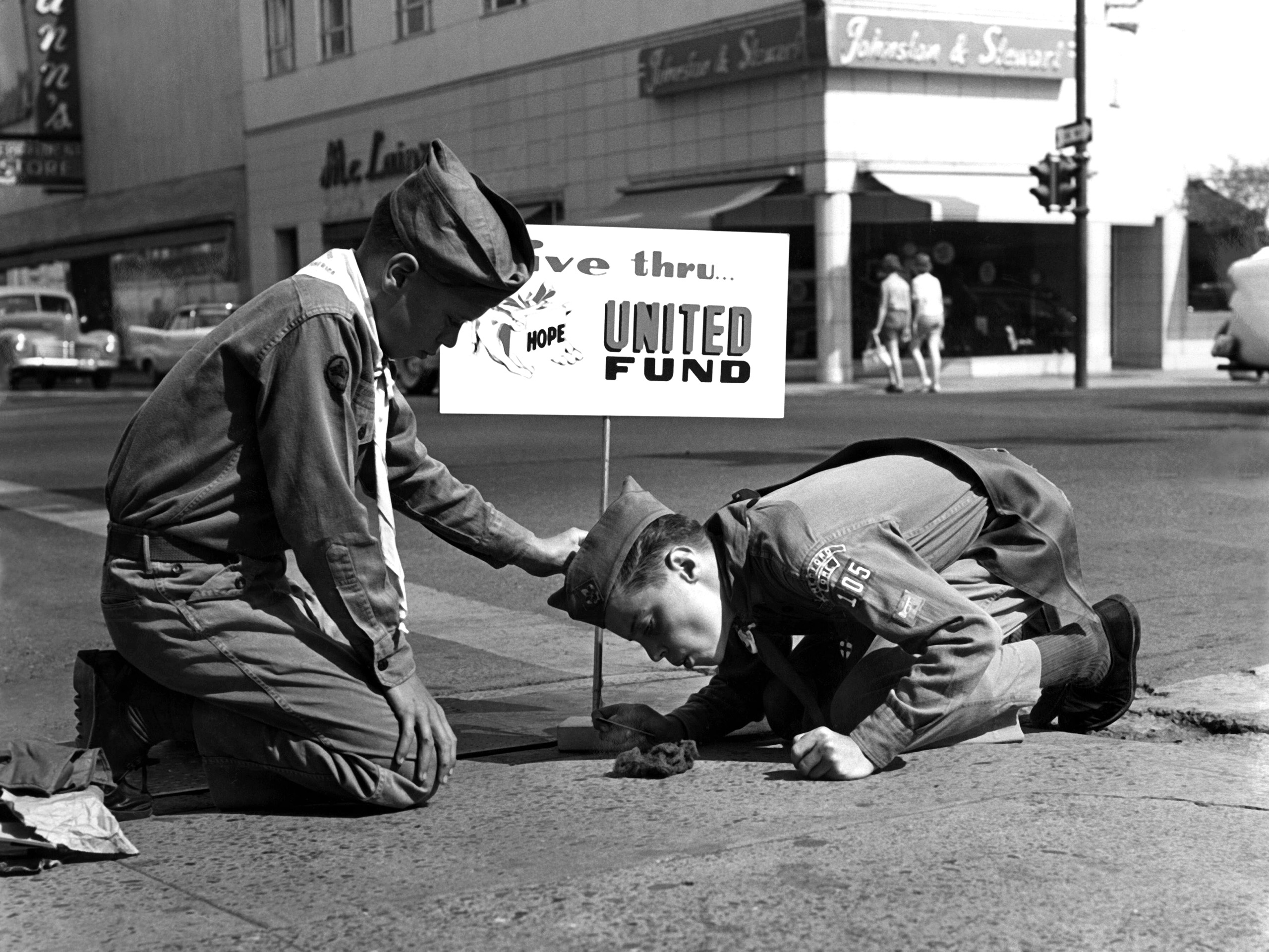 Boy scouts starting fire, circa 1960.