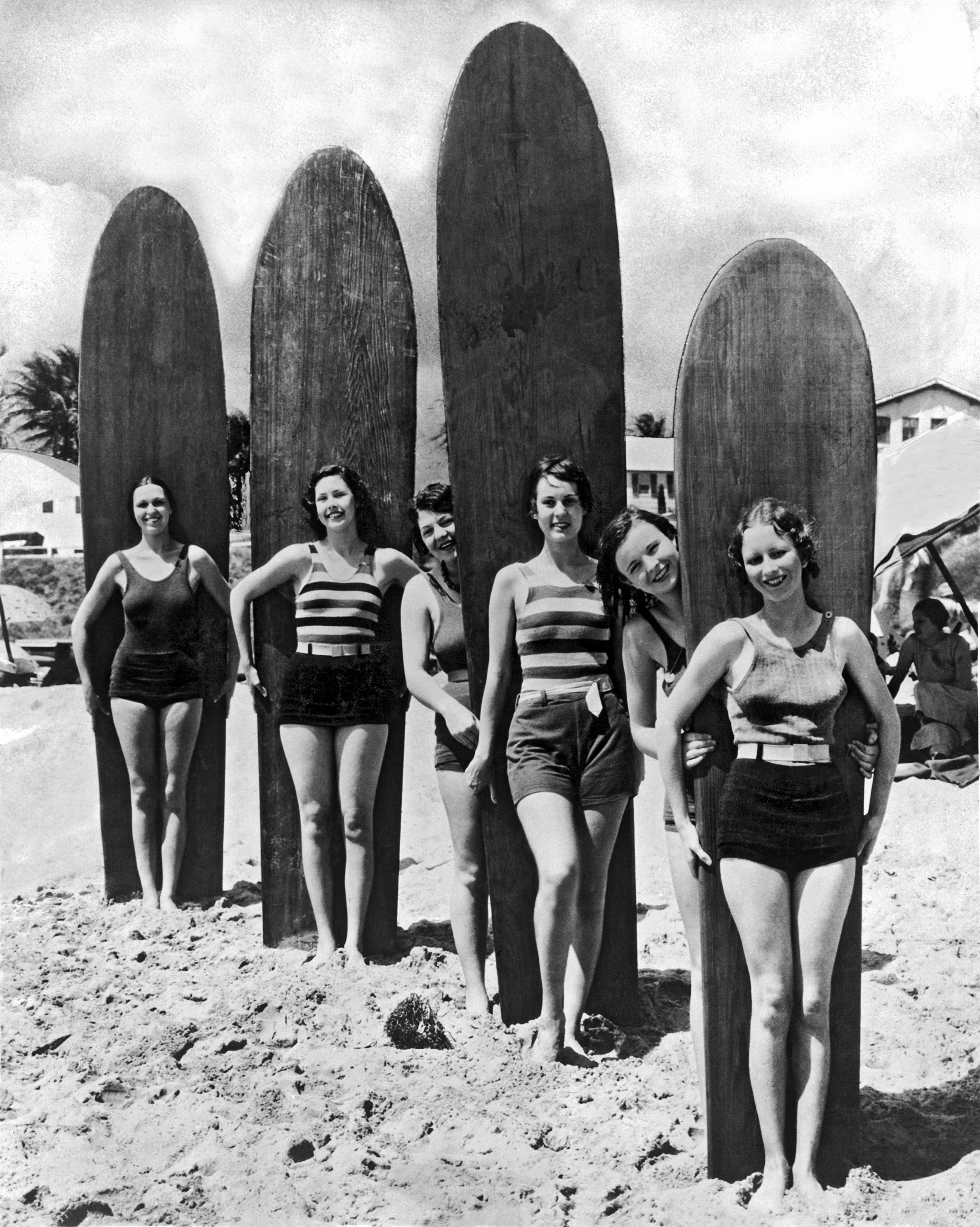 Six young women are ready with their surf boards on a beach in southern California, circa late 1920s/early 1930s.