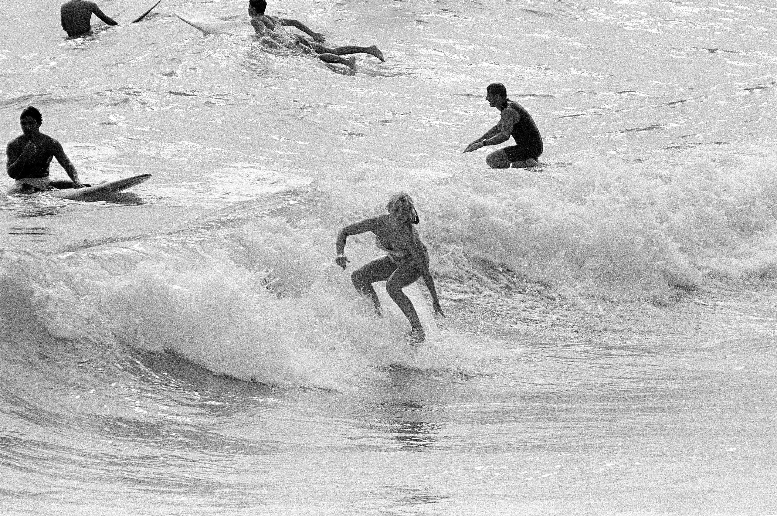 Surfers enjoying the warm waters of Miami Beach, Fla., 1966.