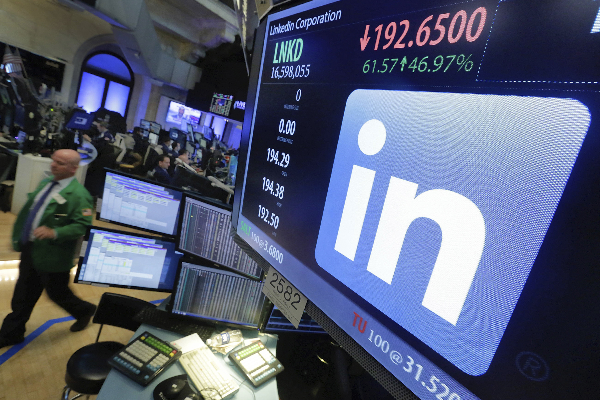 The LinkeIn logo appears on a screen at the post where it trades on the floor of the New York Stock Exchange, June 13, 2016. In a surprise move, Microsoft said Monday that it is buying professional networking service site LinkedIn for about $26.2 billion.