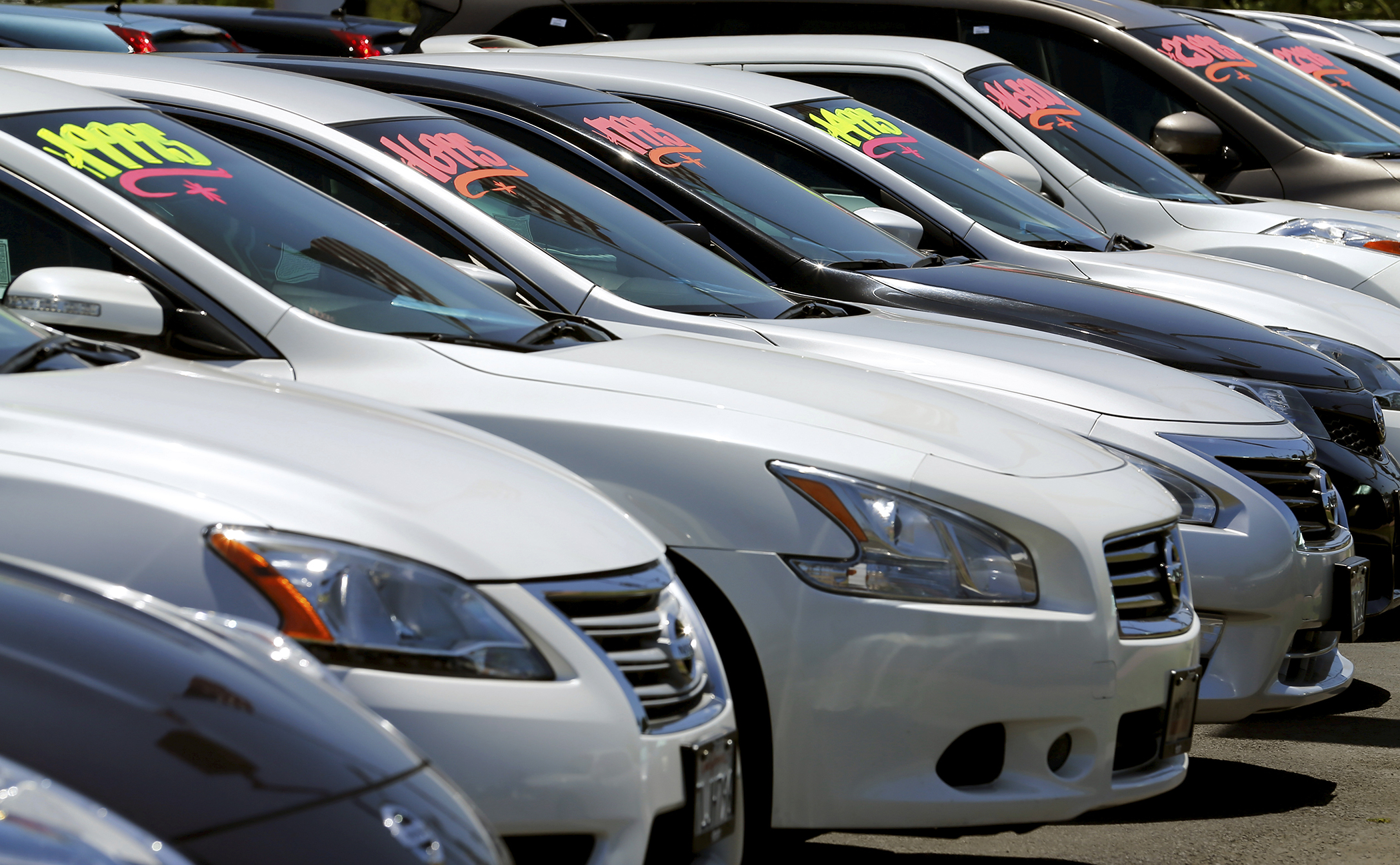Automobiles are shown for sale at a car dealership in Carlsbad, California, on May 2, 2016.