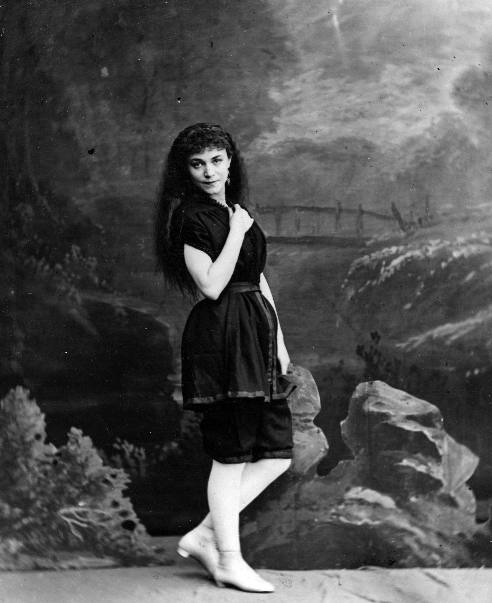 A woman wearing a fashionable bathing costume, circa 1870.