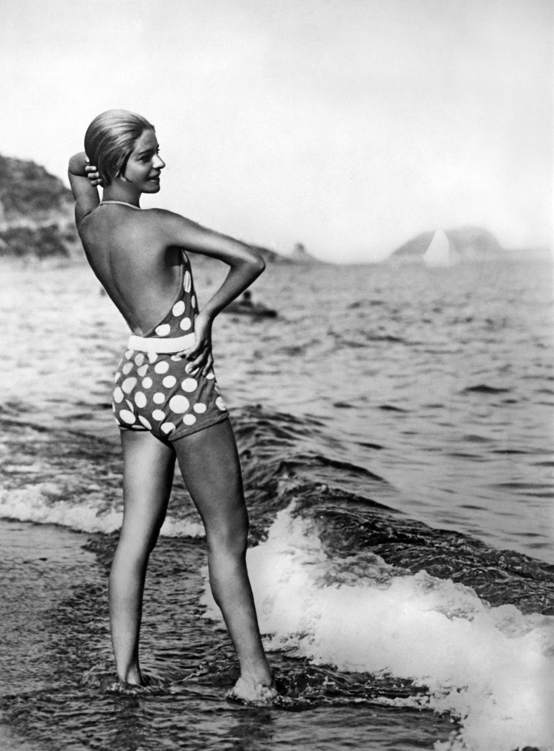 Dancer Alice Nikitina wearing a striking bathing suit at the beach in Alassio, Italy, circa 1929.