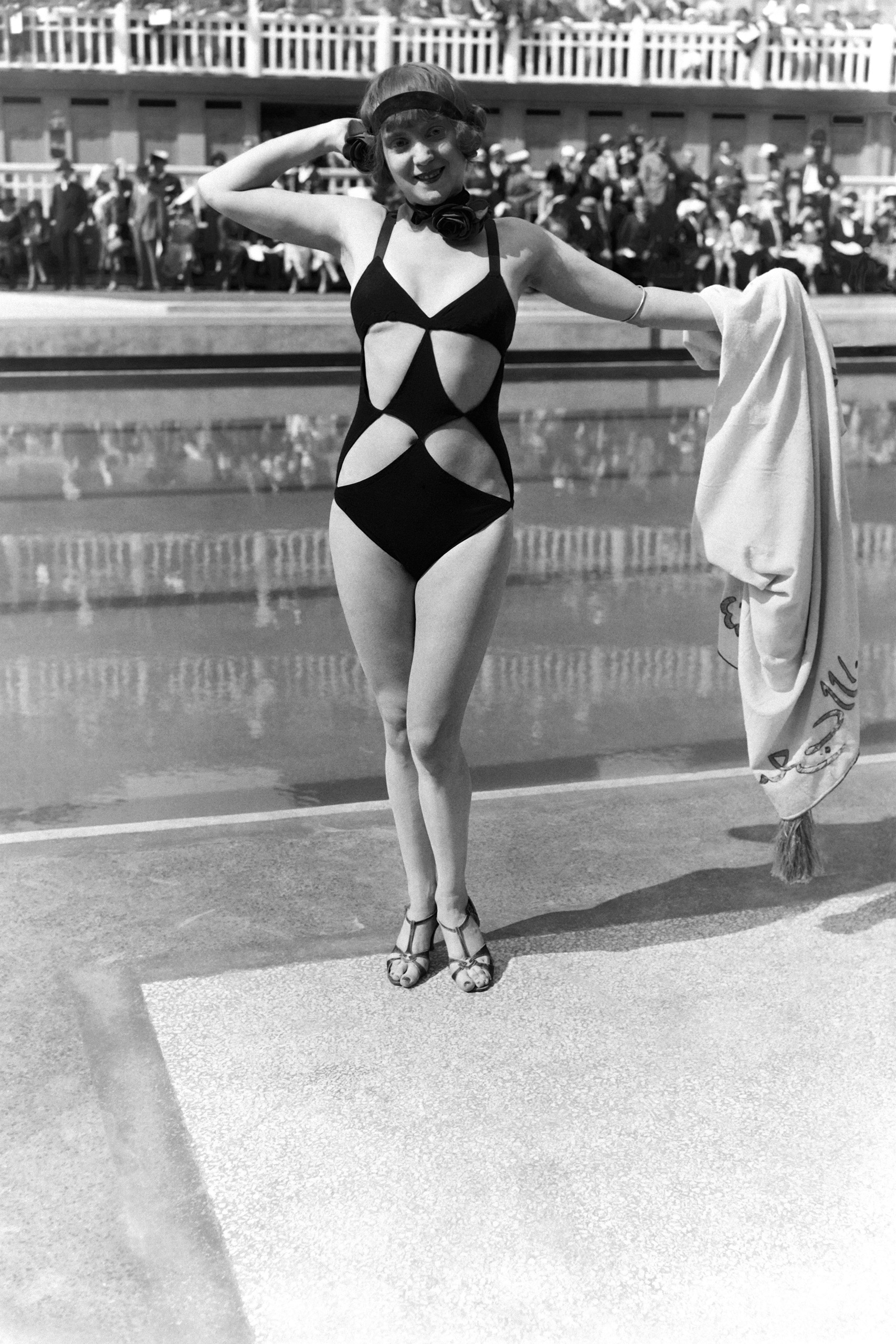 Woman wearing cut-out swimming suit at the Aquatic gala at Molitor swimming pool, on June 23, 1931 in Paris.